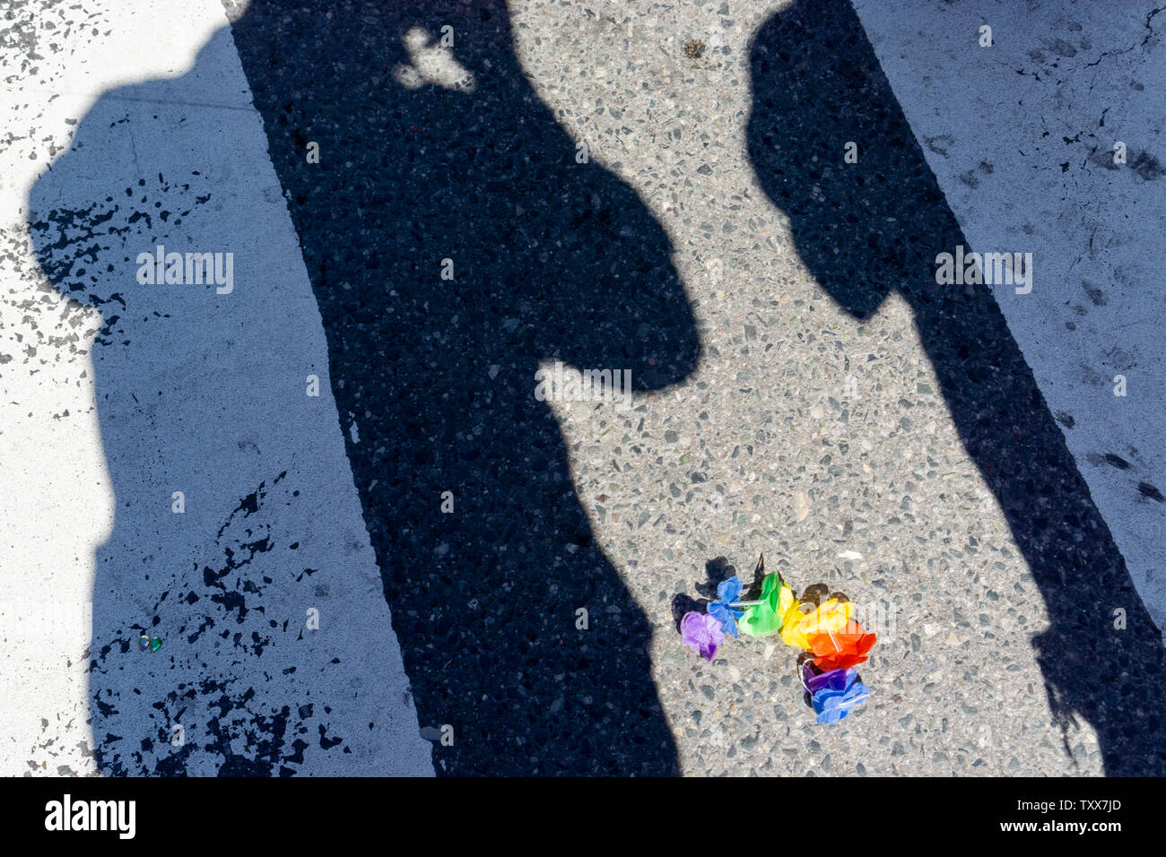 I found this lost Pride rainbow coloured hand or head band lonely on the busy street waiting to be captured by my camera. - Stock Image