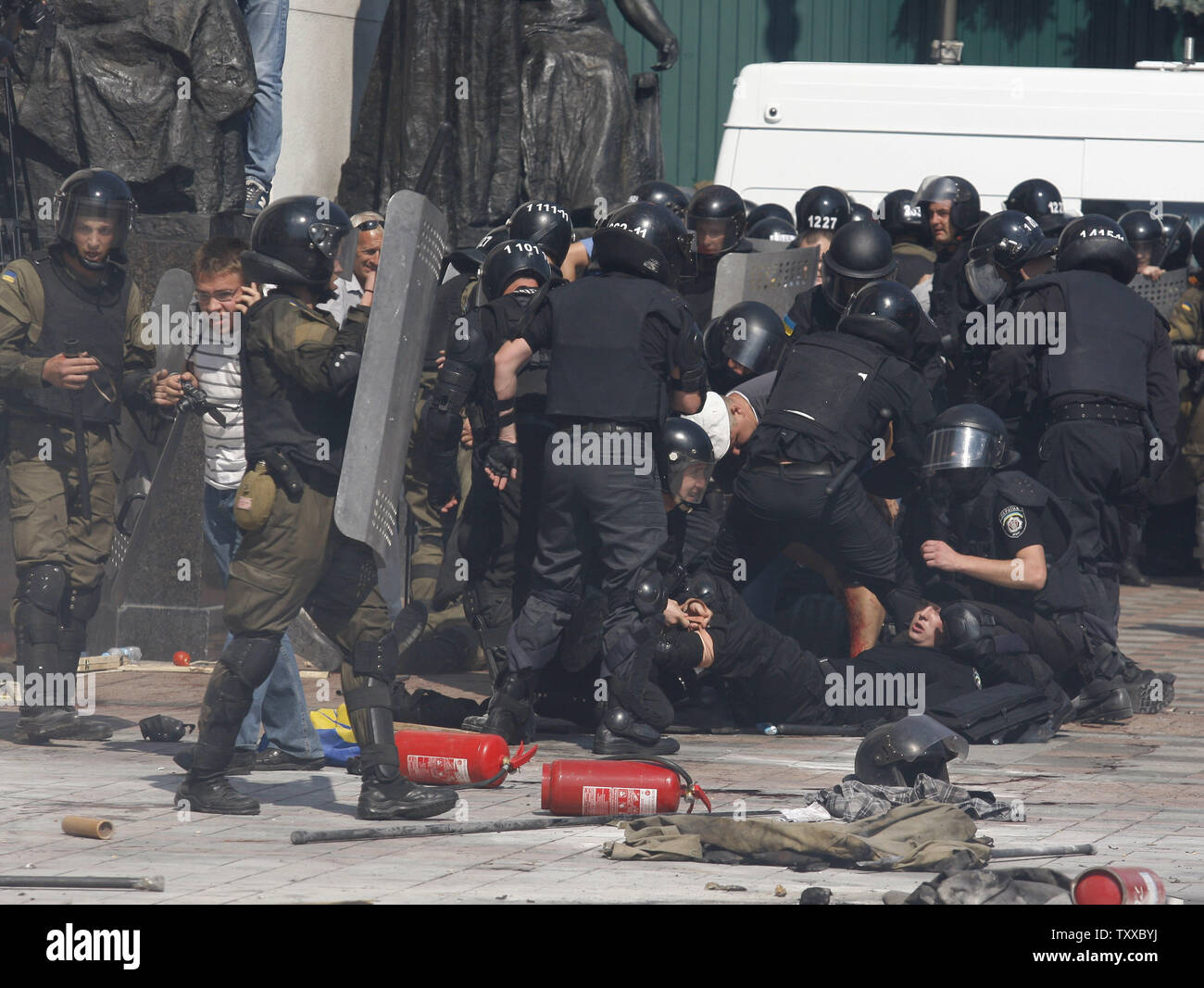 Some Ukrainian riot police officer are injured after a grenade blast during a clash with protesters outside the parliament in Kiev on August 31, 2015. Hundreds of people gathered in front of the parliament to protest against an approved  constitutional amendment on decentralization to separatist regions.   Photo by Ivan Vakolenko/UPI Stock Photo