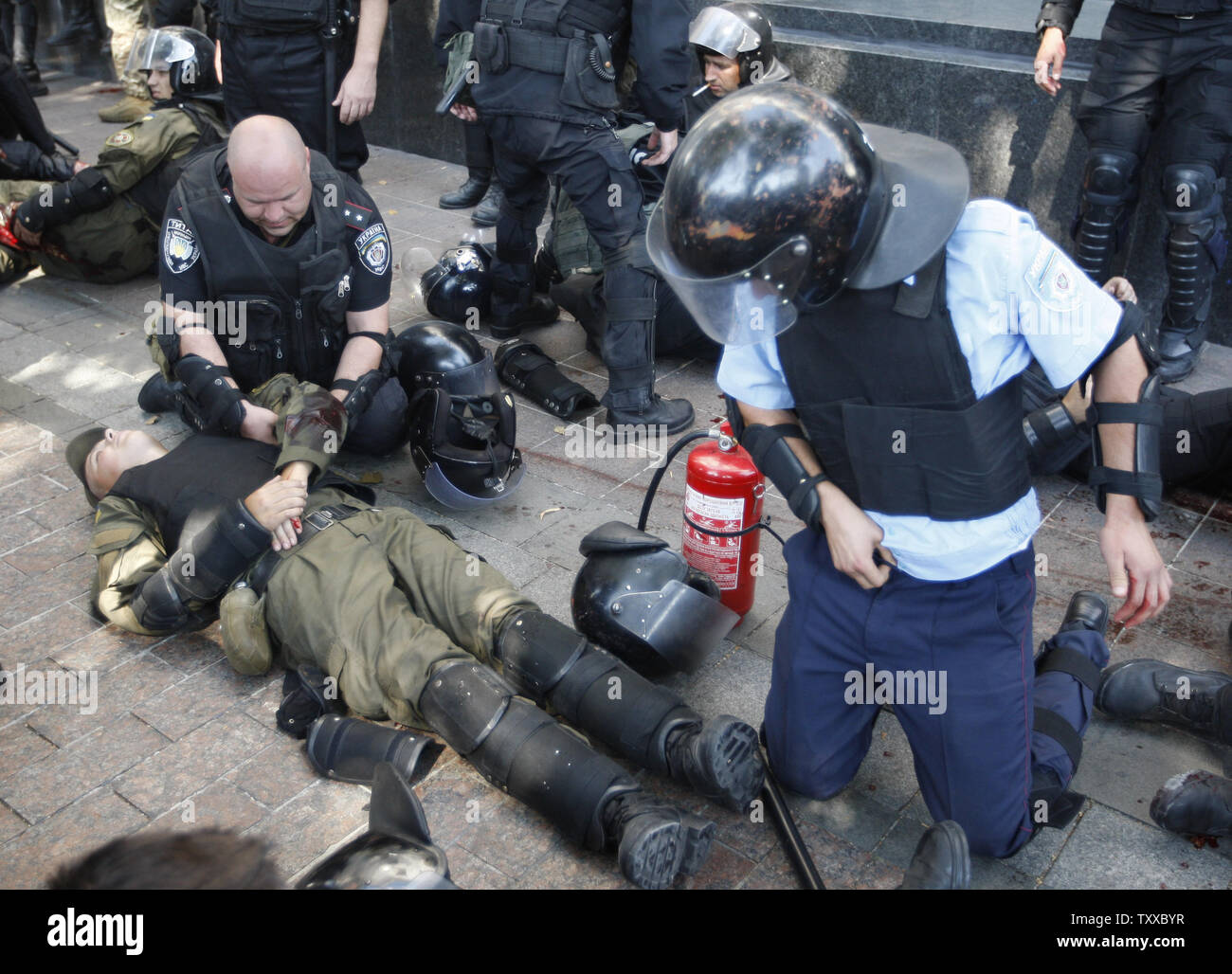 Ukrainian riot police officer is injured after a grenade blast during a clash with protesters outside the parliament in Kiev on August 31, 2015. Hundreds of people gathered in front of the parliament to protest against an approved  constitutional amendment on decentralization to separatist regions.   Photo by Ivan Vakolenko/UPI Stock Photo