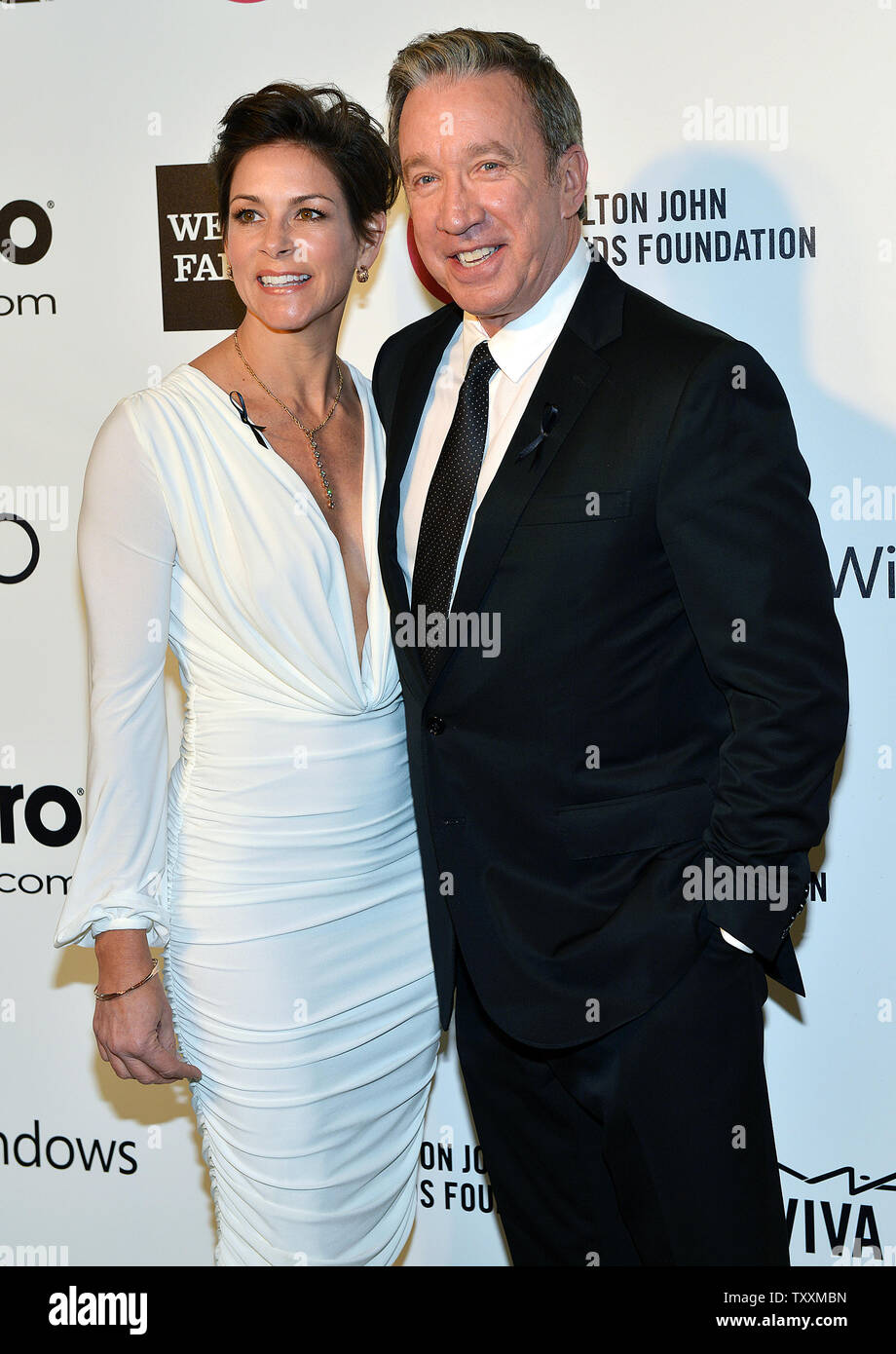 Tim Allen and his wife Jane Hajduk arrive for the Elton John AIDS Foundation Academy Awards Viewing Party at West Hollywood Park in Los Angeles on March 2, 2014.  UPI/Christine Chew - Stock Image