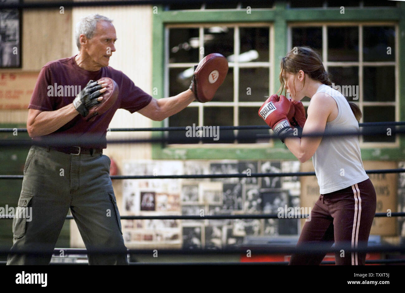 """Clint Eastwood (L) and Hilary Swank are pictured in a scene from best motion picture of the year nominee """"Million Dollar Baby."""" Eastwood and Swank are also nominated for a best actor and actress respectively. Eastwood was also nominated for the third time for best director.  (UPI Photo/AMPAS HO) Stock Photo"""