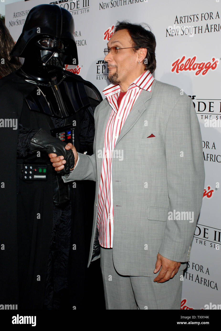 U S Actor Jimmy Smits Who Plays Senator Bail Organa Greets A Darth Vader Character As He Arrives For The Premiere Of Star Wars Episode Iii Revenge Of The Sith In Los Angeles