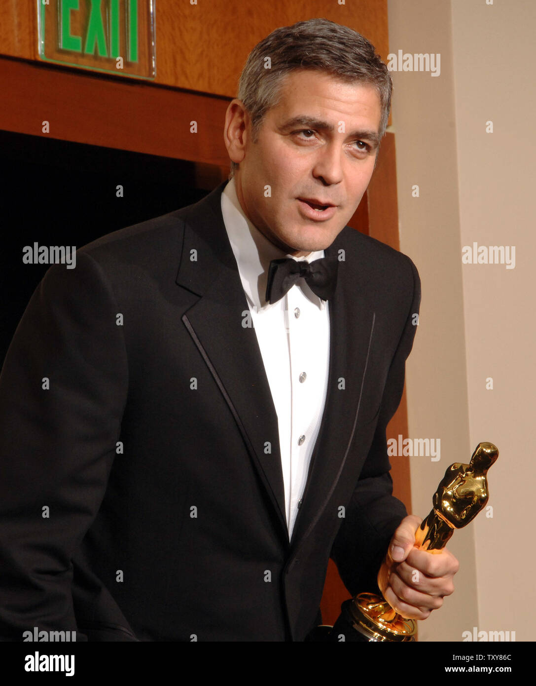 George Clooney appears backstage with the best supporting