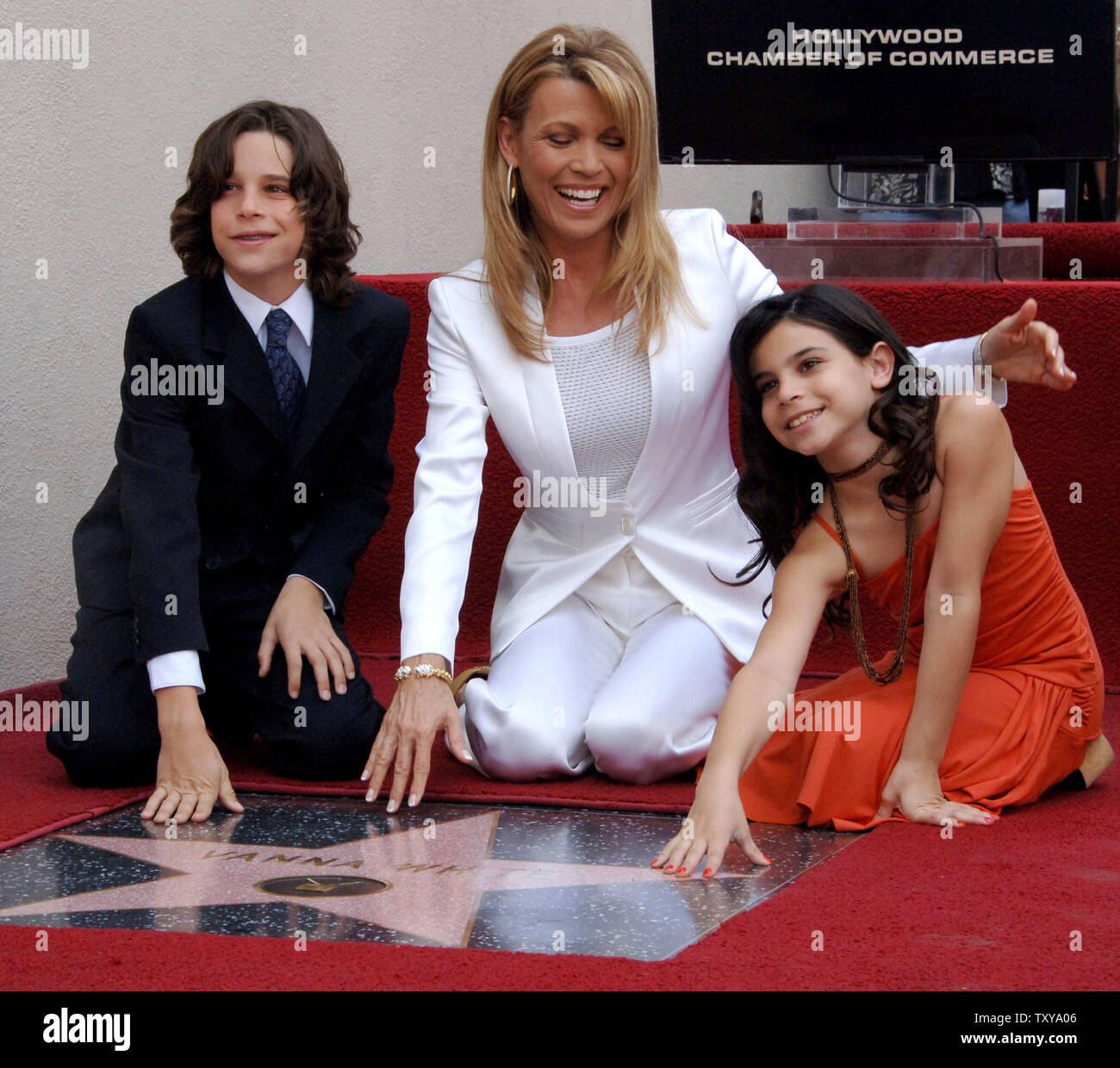 57fa38f39d Television personality Vanna White (C) smiles for photographers with her  12-year-old son Nicholas Santopletro (L) and 9-year-old daughter Giovanna  ...