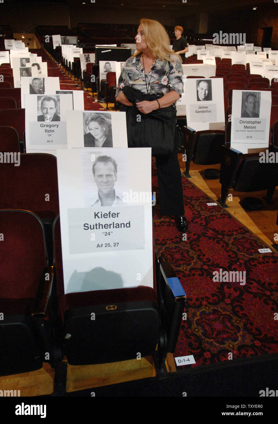Celebrity seat cards mark the Shrine Auditorium which is being prepared for the 58th annual Primetime Emmy Awards in Los Angeles on August 25, 2006. The award show airs Sunday, Aug. 27. (UPI Photo/Jim Ruymen) - Stock Image