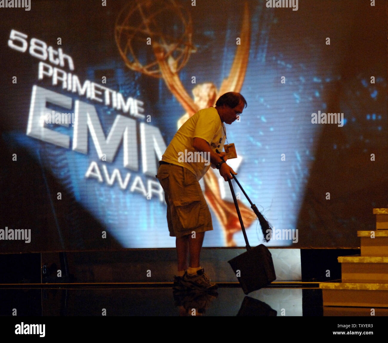 A worker makes final stage preparations at the Shrine Auditorium for the 58th annual Primetime Emmy Awards in Los Angeles on August 25, 2006. The award show airs Sunday, Aug. 27. (UPI Photo/Jim Ruymen) - Stock Image