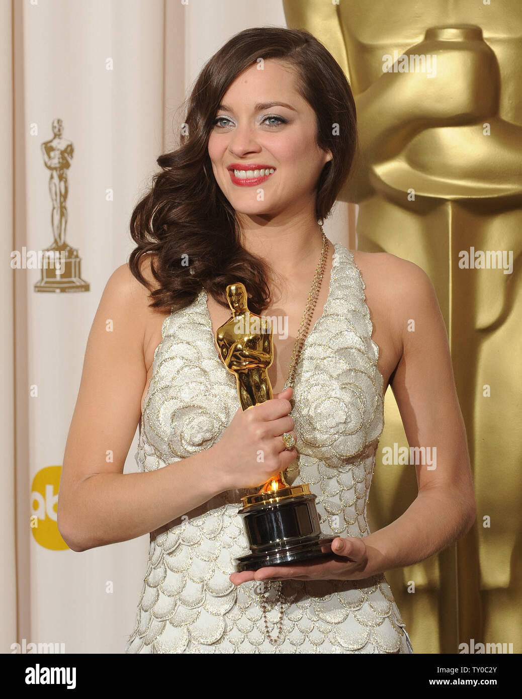 Actress Marion Cotillard Poses With Her Oscar For Best