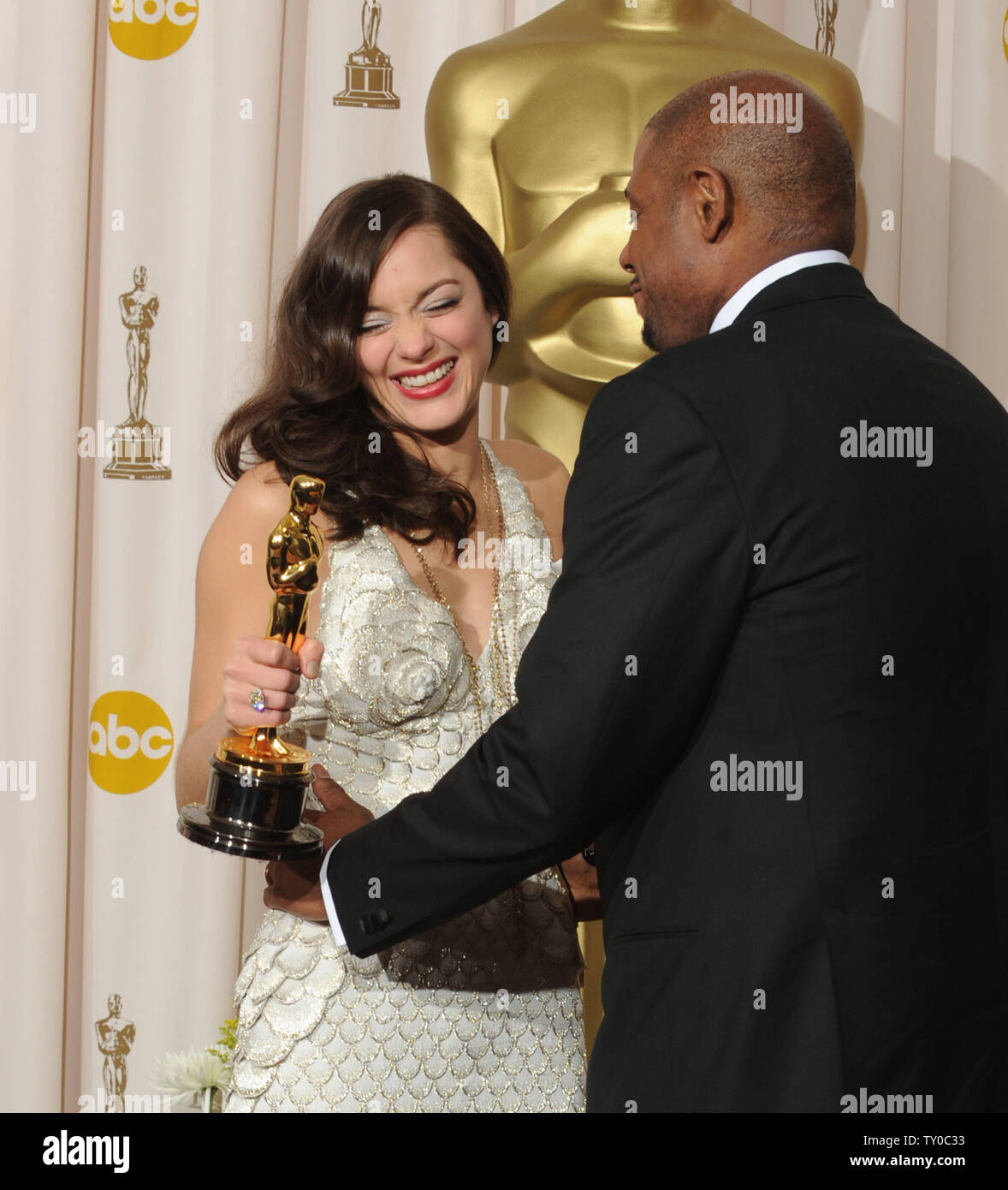 Presenter Forest Whitaker Poses With Actress Marion
