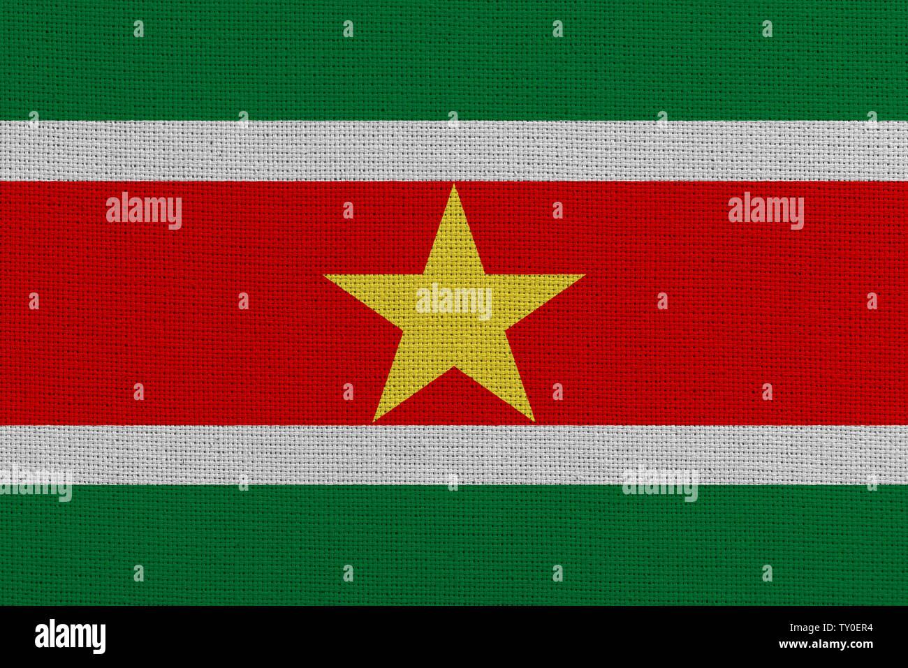 Suriname fabric flag. Patriotic background. National flag of Suriname - Stock Image