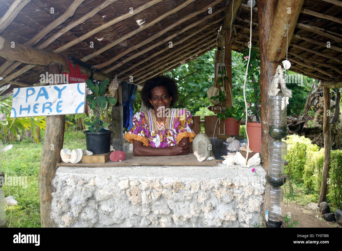 Woman at entry station to marine reserve, Top Rock, Saama, Efate, Vanuatu. No MR or PR - Stock Image