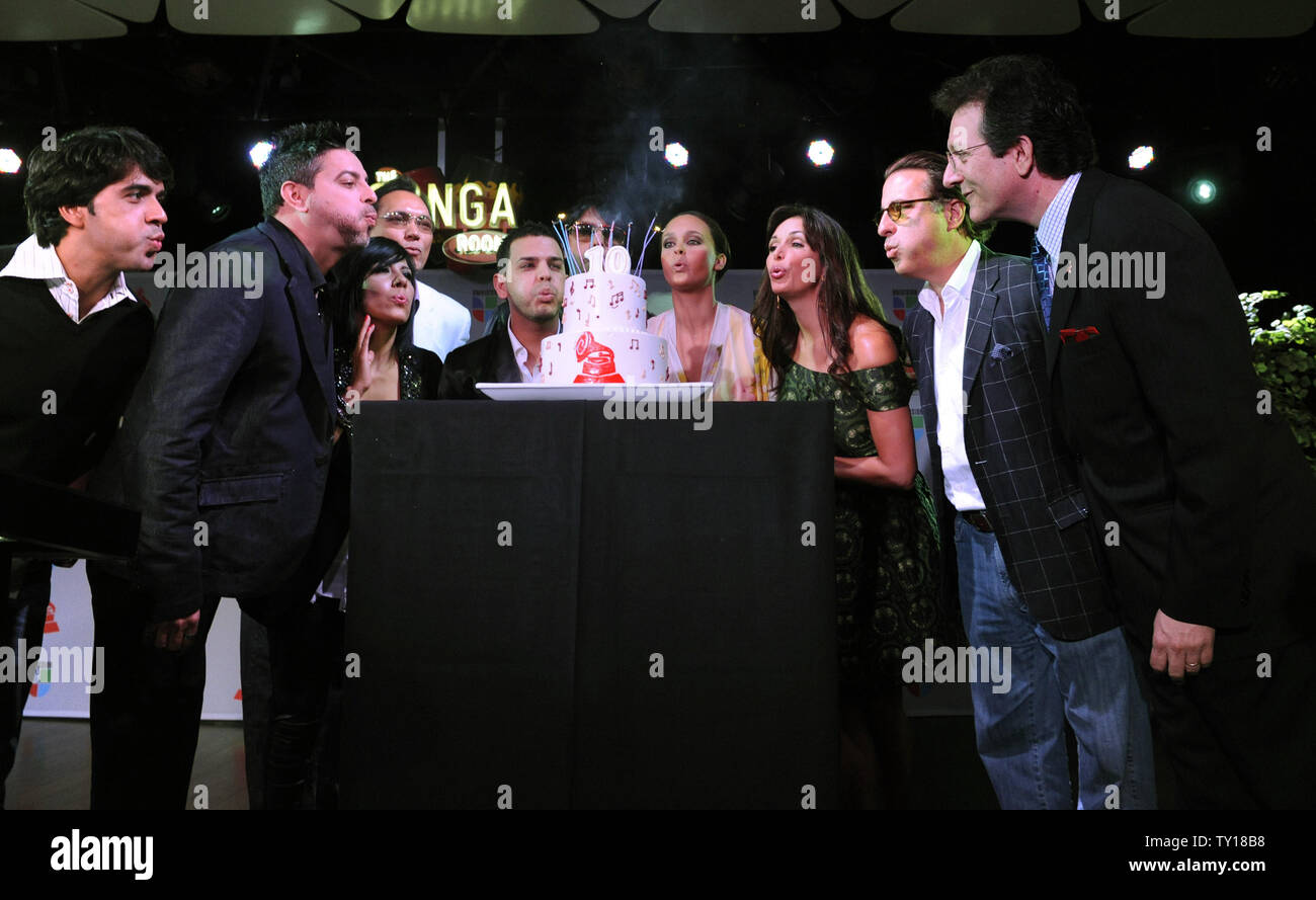 Participants blow out candles on a birthday cake at the nominee announcement for the 10th annual Latin GRAMMYS in Los Angeles on September 17, 2009.      UPI/ Phil McCarten - Stock Image