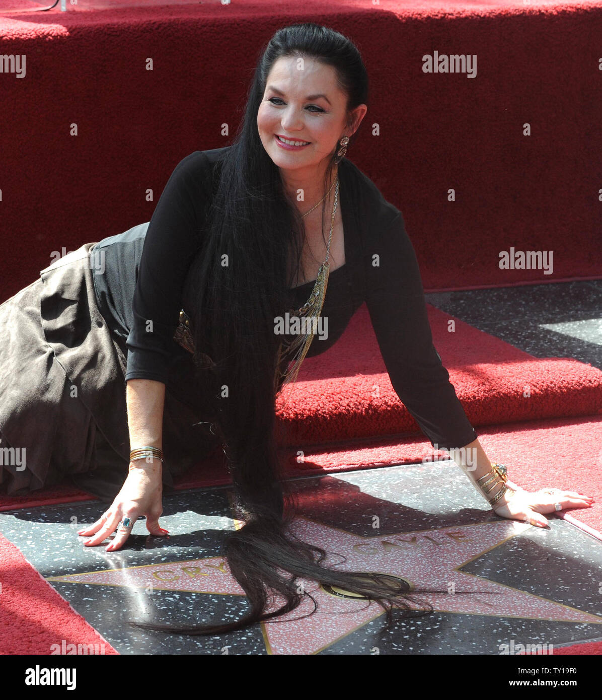 Singer Crystal Gayle places her signature mane atop her star during an unveiling ceremony honoring her with the 2, 390th star on the Hollywood Walk of Fame in Los Angeles on October 2, 2009.     UPI/Jim Ruymen - Stock Image