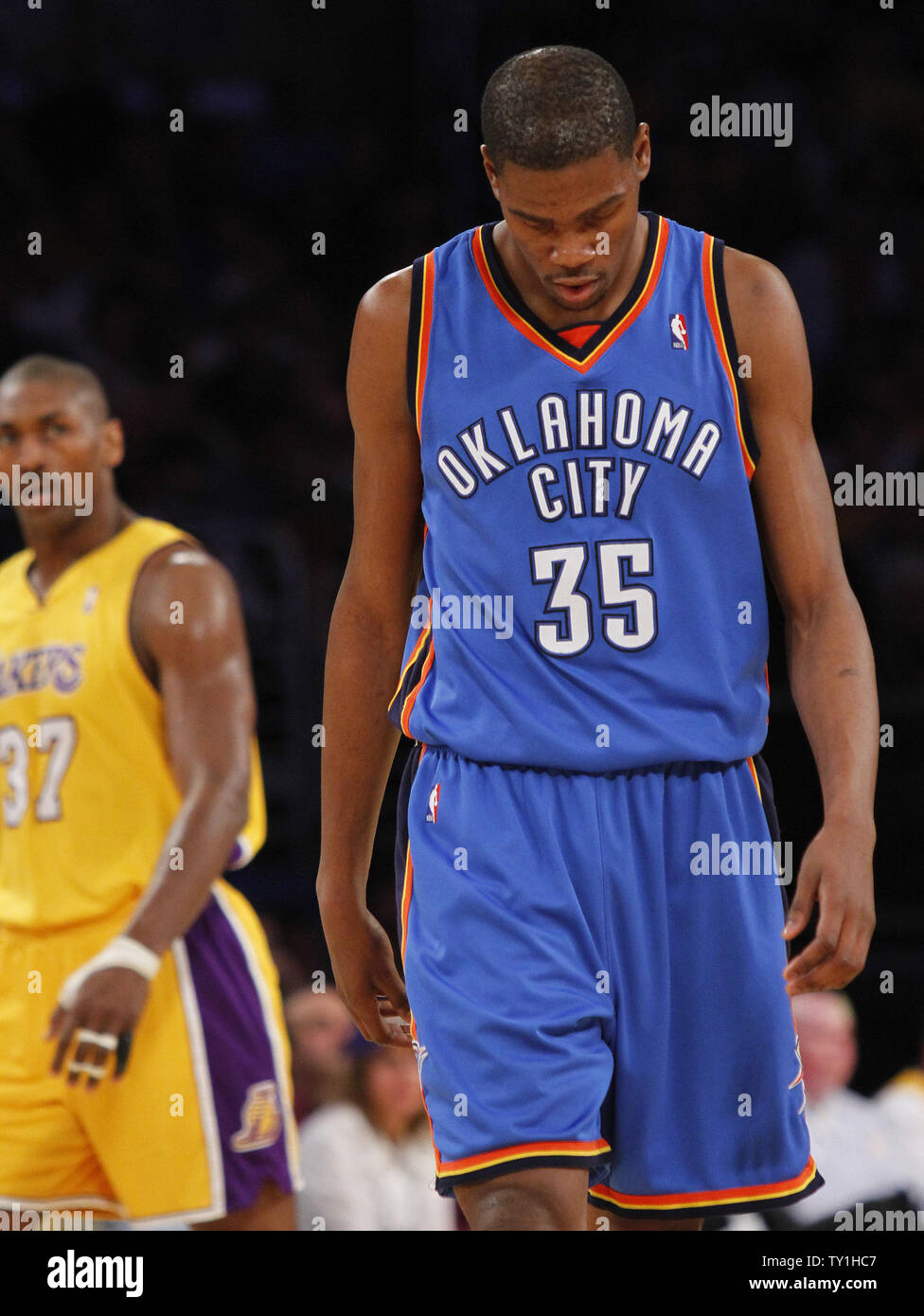 Oklahoma City Thunder forward Kevin Durant is dejected as Los Angeles Lakers' Ron Artest, left, watches at the end of the first half of Game 5 of their Western Conference playoff series at Staples Center in Los Angeles on April 27, 2010. The Lakers won 111-87. UPI Photo/Lori Shepler Stock Photo