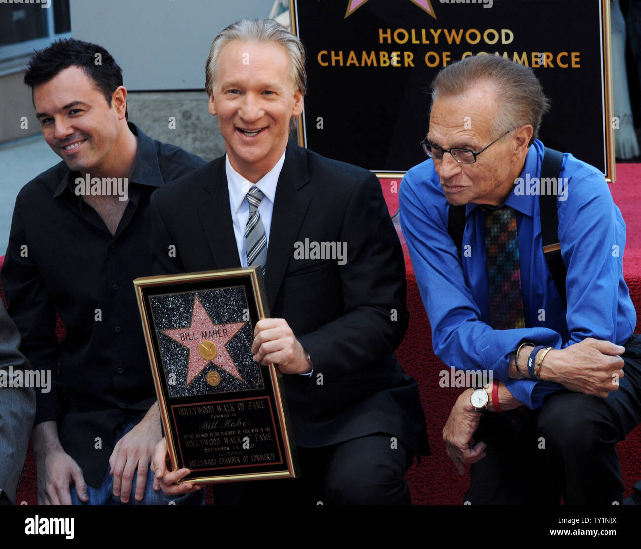 Comedian and television host Bill Maher (C) is joined by animator Seth MacFarlane (L) and broadcaster Larry King during an unveiling ceremony honoring him with the 2,417th star on the Hollywood Walk of Fame in Los Angeles on September 14, 2010.     UPI/Jim Ruymen Stock Photo