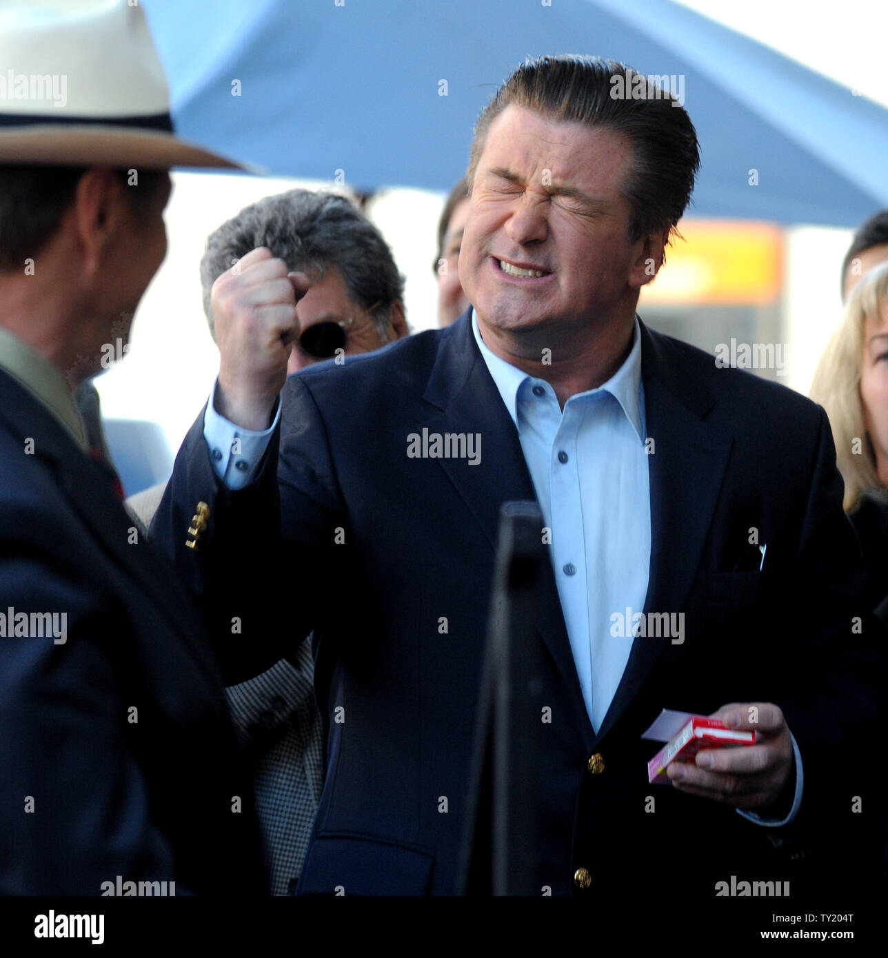 Actor Alec Baldwin reacts during an unveiling ceremony honoring him with the 2,433rd star on the Hollywood Walk of Fame in Los Angeles on February 14, 2011.  UPI/Jim Ruymen Stock Photo
