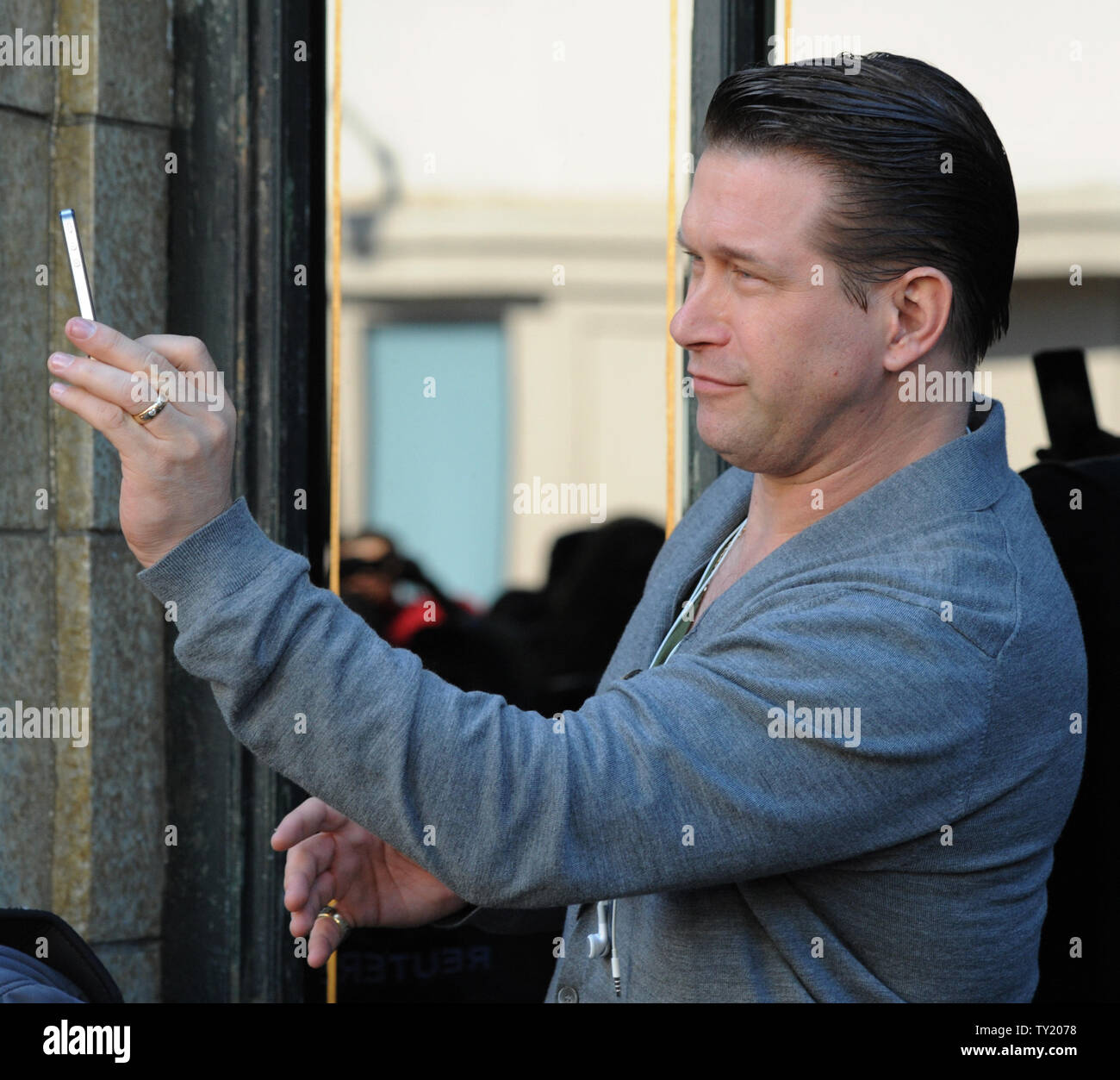 Actor Stephen Baldwin records the moment during an unveiling ceremony honoring his brother Alec Baldwin with the 2,433rd star on the Hollywood Walk of Fame in Los Angeles on February 14, 2011.  UPI/Jim Ruymen Stock Photo