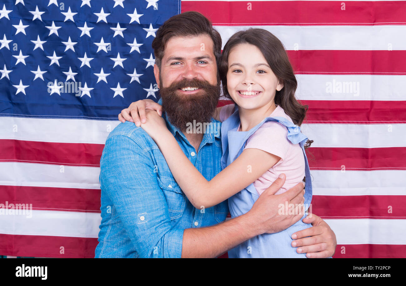 Freedom fundamental right. Independence is happiness. Independence day holiday. How do americans celebrate independence day. Father american bearded hipster and cute little daughter with USA flag. - Stock Image