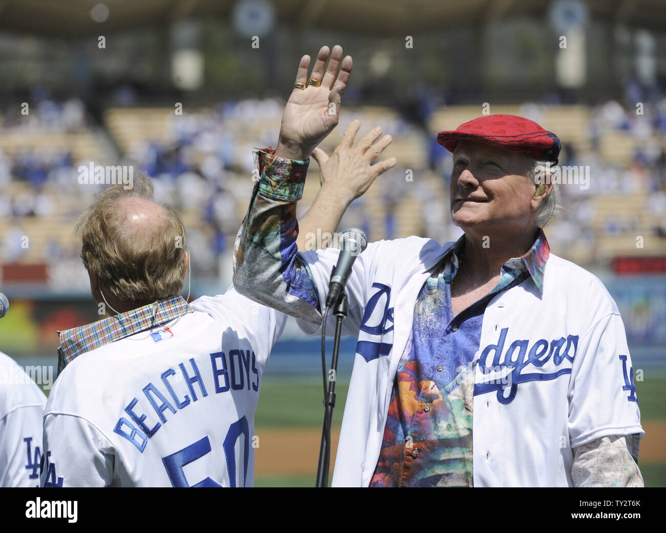 Mike Love of The Beach Boys waves to the crowd before the Los Angeles Dodgers play the Pittsburgh Pirates on opening day during the 50th Anniversary of Dodger Stadium in Los Angeles on April 10, 2012.        UPI Photo/ Phil McCarten Stock Photo