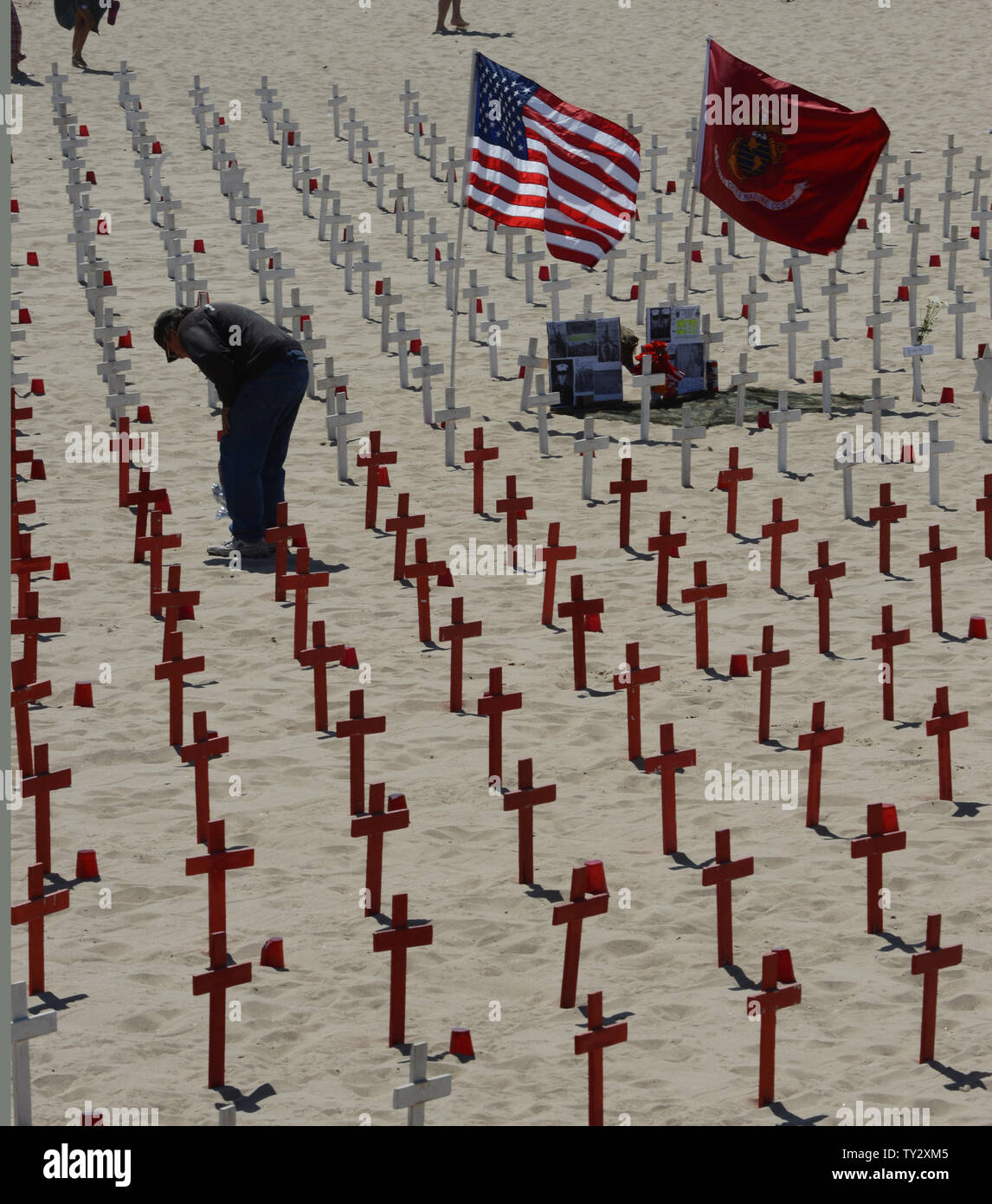 A man walks amid crosses on display at the Arlington West Memorial Project in Santa Monica, California on May 27, 2012. The beach memorial represents the 4,486 soldiers killed in Iraq and 1,984 killed in Afghanistan for a total of 6,470 dead in both wars.  UPI/Jim Ruymen - Stock Image