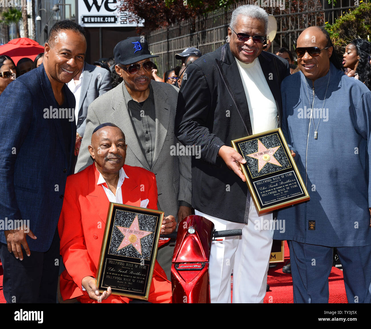 Eddie Willis (L) and Jack Ashford, the remaining survivors of The Funk Brothers, hold replica plaques during an unveiling ceremony, honoring them with the 2,493rd star on the Hollywood Walk of Fame in Los Angeles on March 21, 2013. The pair are joined by Ray Parker Jr., Paul Riser and Stevie Wonder (L-R).  UPI/Jim Ruymen - Stock Image