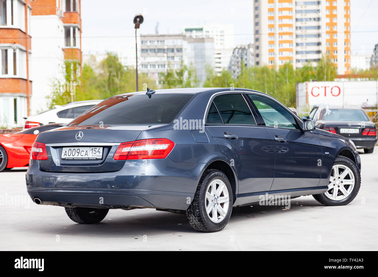 Novosibirsk Russia 05 13 2019 Gray And Blue Mercedes Benz E Class E200 2010 Year Rear View With Dark Gray Interior In Excellent Condition In A Par Stock Photo Alamy