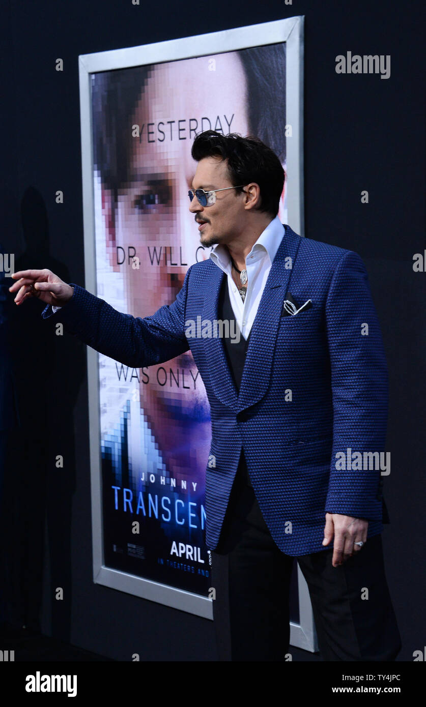 Cast member Johnny Depp attends the premiere of the sci-fi motion picture thriller 'Transcendence' at the Regency Village Theatre in the Westwood section of Los Angeles on April 10, 2014 Storyline: A terminally ill scientist uploads his mind to a computer. This grants him power beyond his wildest dreams, and soon he becomes unstoppable.   UPI/Jim Ruymen - Stock Image