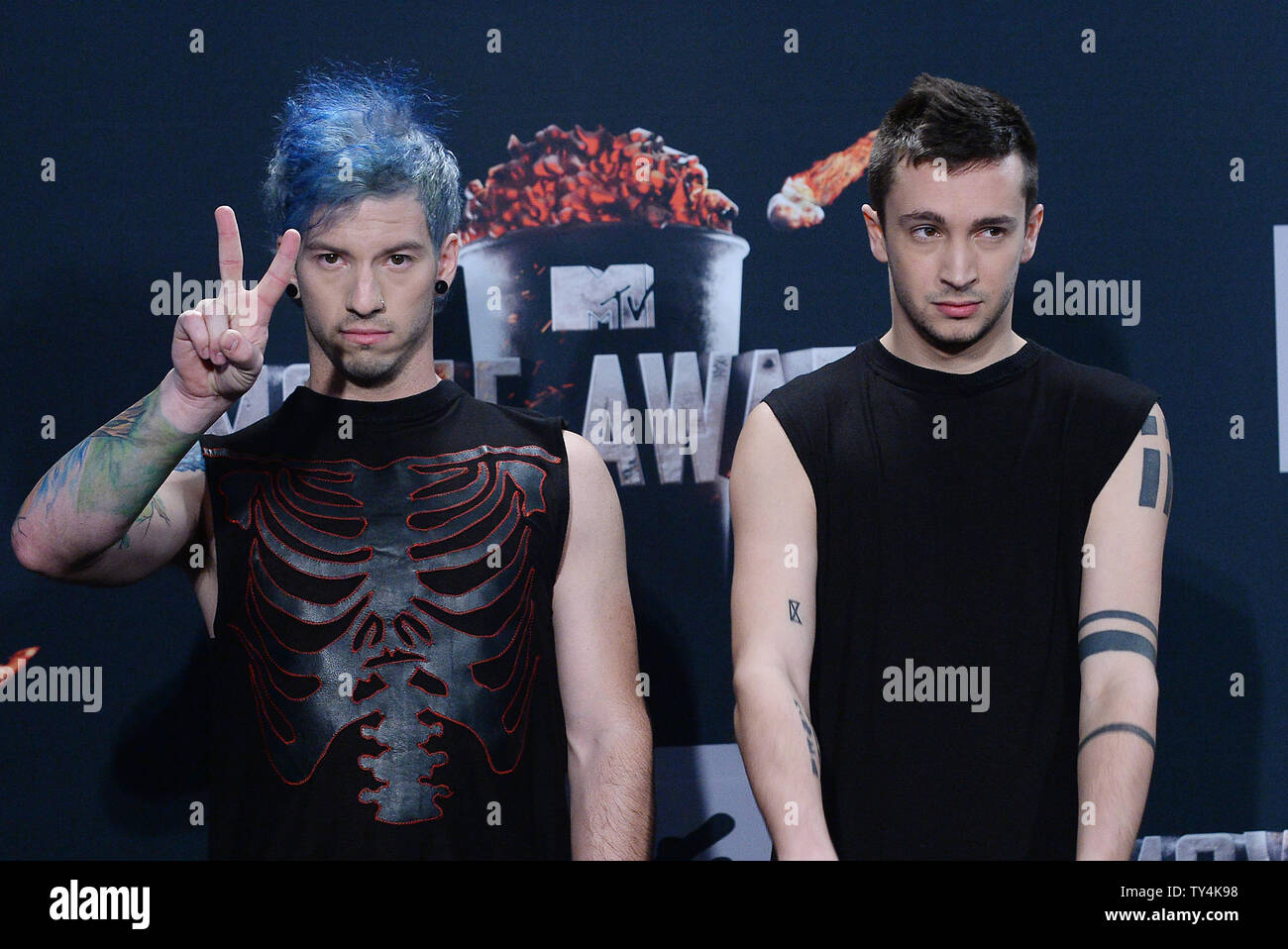 Musicians Josh Dun and Tyler Joseph of Twenty One Pilots appear backstage at The MTV Movie Awards at Nokia Theatre L.A. Live in Los Angeles, California on April 13, 2014.  UPI/Jim Ruymen Stock Photo