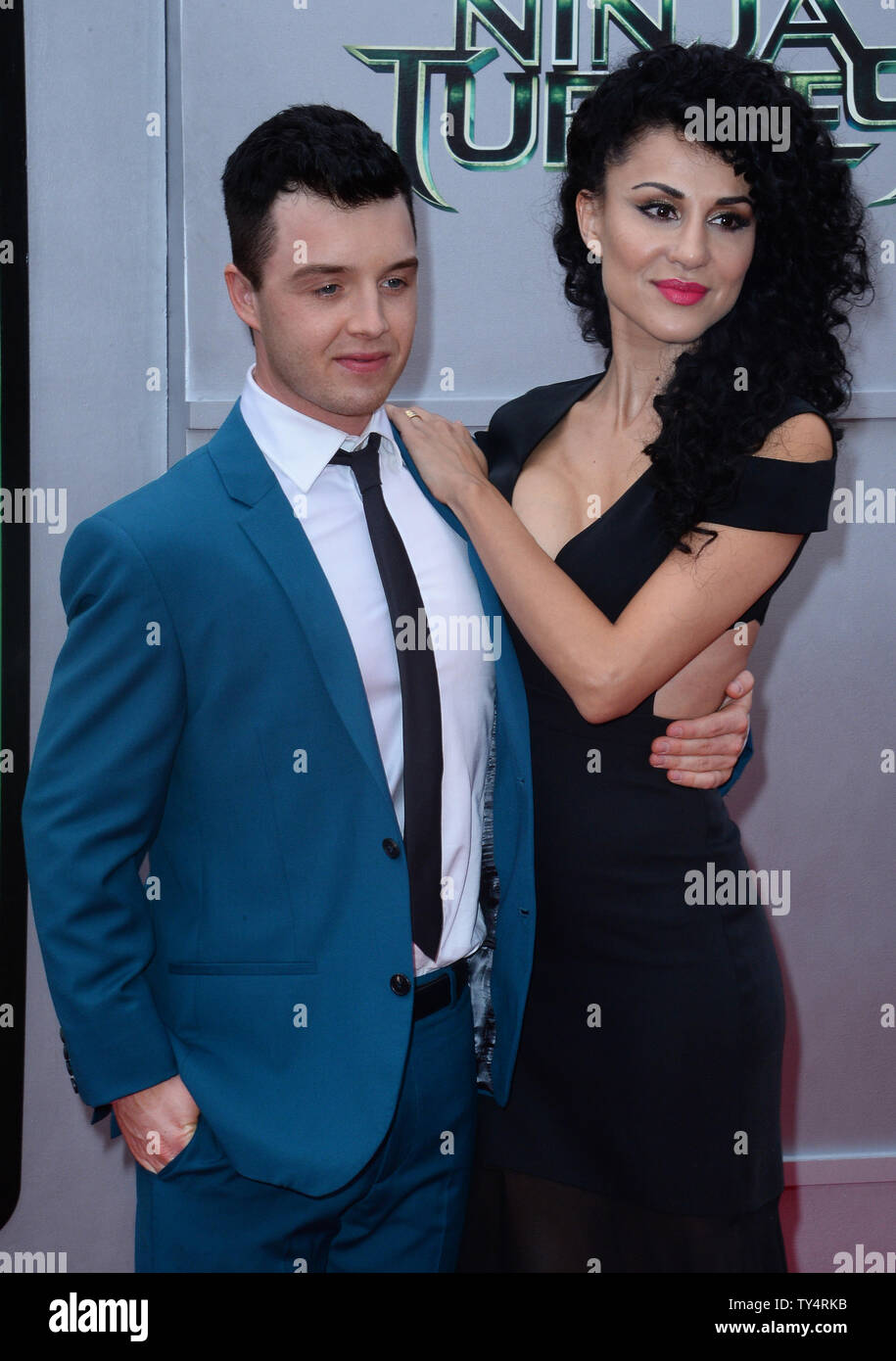 Cast Member Noel Fisher And Actress Layla Alizada Attend The Premiere Of The Motion Picture Sci Fi Fantasy Teenage Mutant Ninja Turtles At The Regency Village Theatre In The Westwood Section Of Los