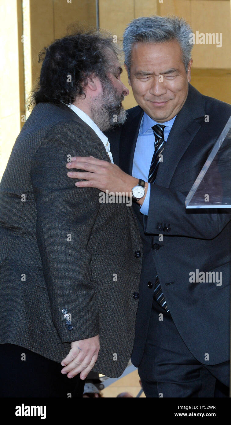 Director Peter Jackson (L) shares a moment with CEO of Warner Bros