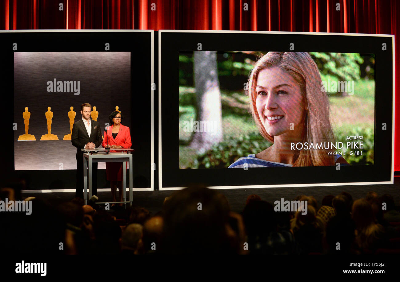 Actor Chris Pine (L) and Academy of Motion Picture Arts and Sciences President Cheryl Boone Isaacs announce Rosamund Pike as a nominee for Best Actress in the film 'Gone Girl' during the 87th Academy Awards nominations announcements at the Samuel Goldwyn Theatre in Beverly Hills, California on January 15, 2015. The 87th annual Academy Awards will be televised live on ABC from Los Angeles February 22nd.  Photo by Jim Ruymen/UPI - Stock Image