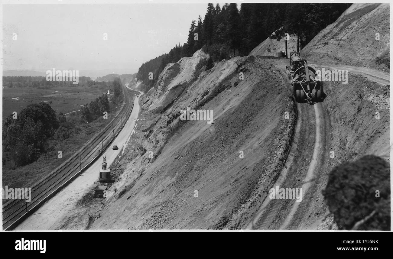 General view to show heavy cuts involved in the work. Material consists of clay, loam and rock. No rock yet required to be shot. Shovel at roadway engaged in removing material shoveled over from top by dozer and drag line, top right background. Roadbed to be 72' minimum width.; Scope and content:  Pacific Highway, Woodland - Stock Image