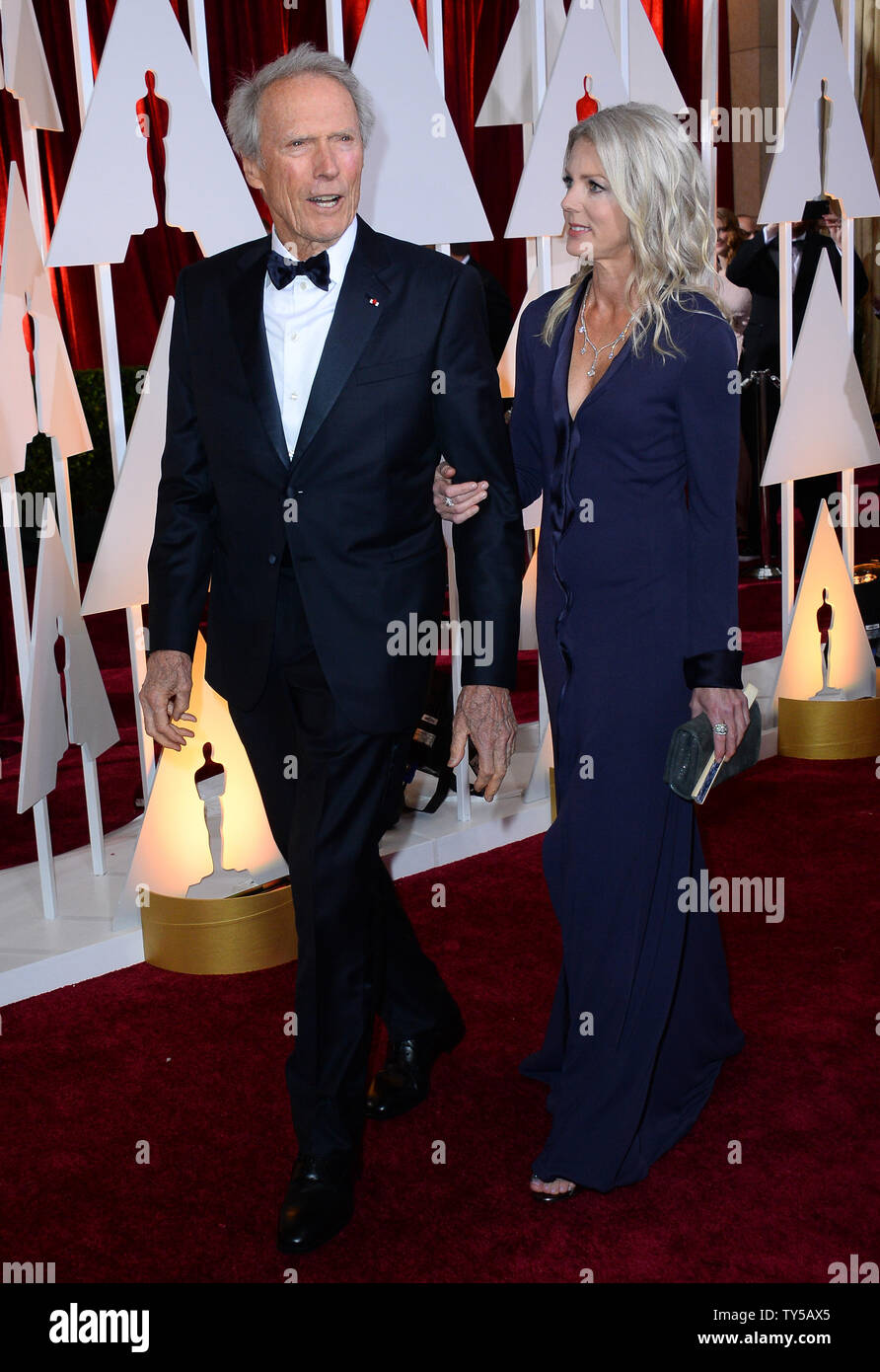 Director Clint Eastwood (L) and Christina Sandera arrive at the 87th Academy Awards at the Hollywood & Highland Center in Los Angeles on February 22, 2015. Photo by Jim Ruymen/UPI Stock Photo