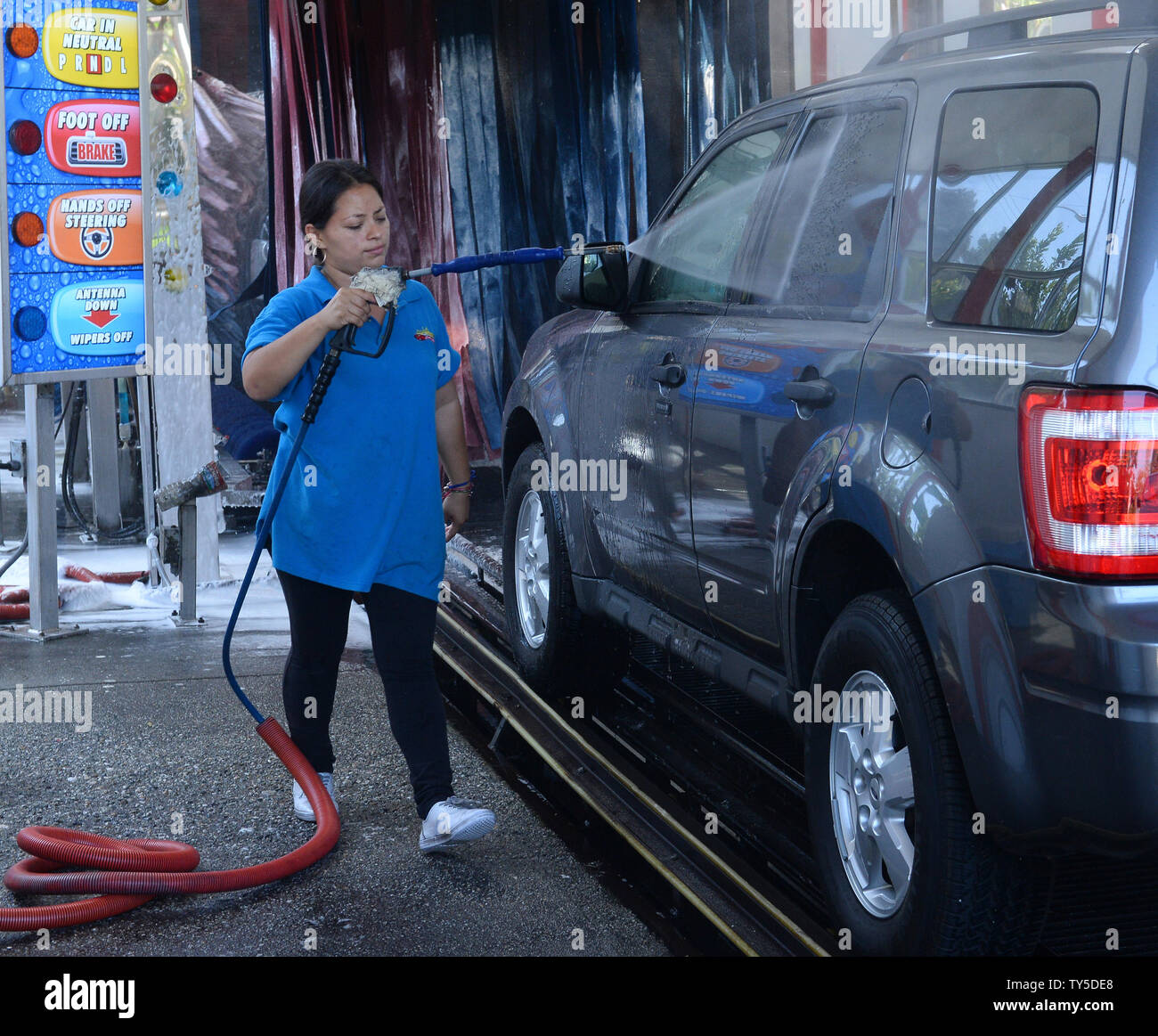 A Worker Sprays Water On A Vehicle Entering A Car Wash In Los Angeles On April 2 2015 Gov Jerry Brown Ordered Mandatory Water Use Reductions For The First Time In California S