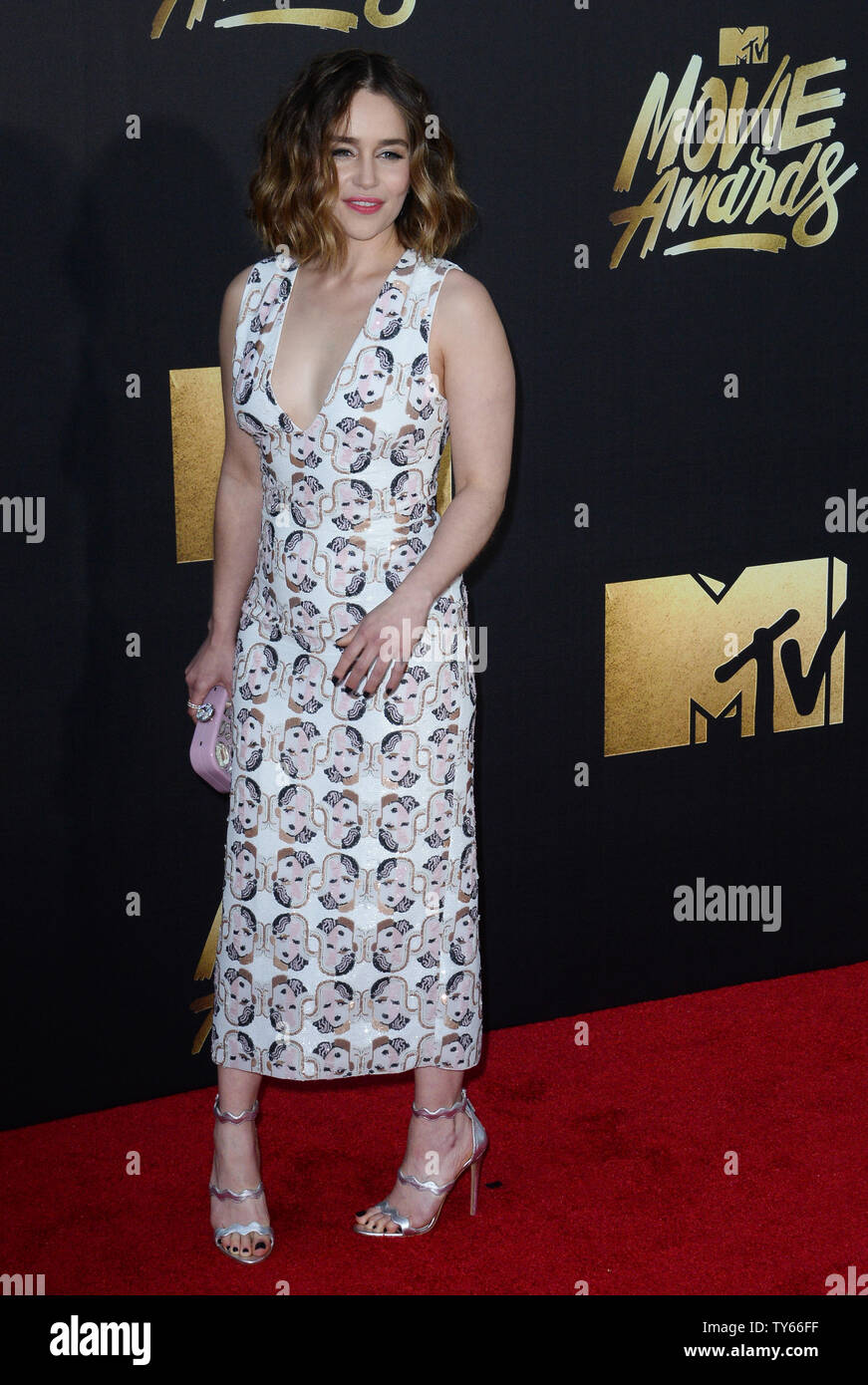 Actress Emilia Clarke attends the MTV Movie Awards at Warner Bros. Studios in Burbank, California on April 9, 2016. The MTV Movie Awards airs Sunday, April 10 at 8pm ET/PT.  Photo by Jim Ruymen/UPI - Stock Image