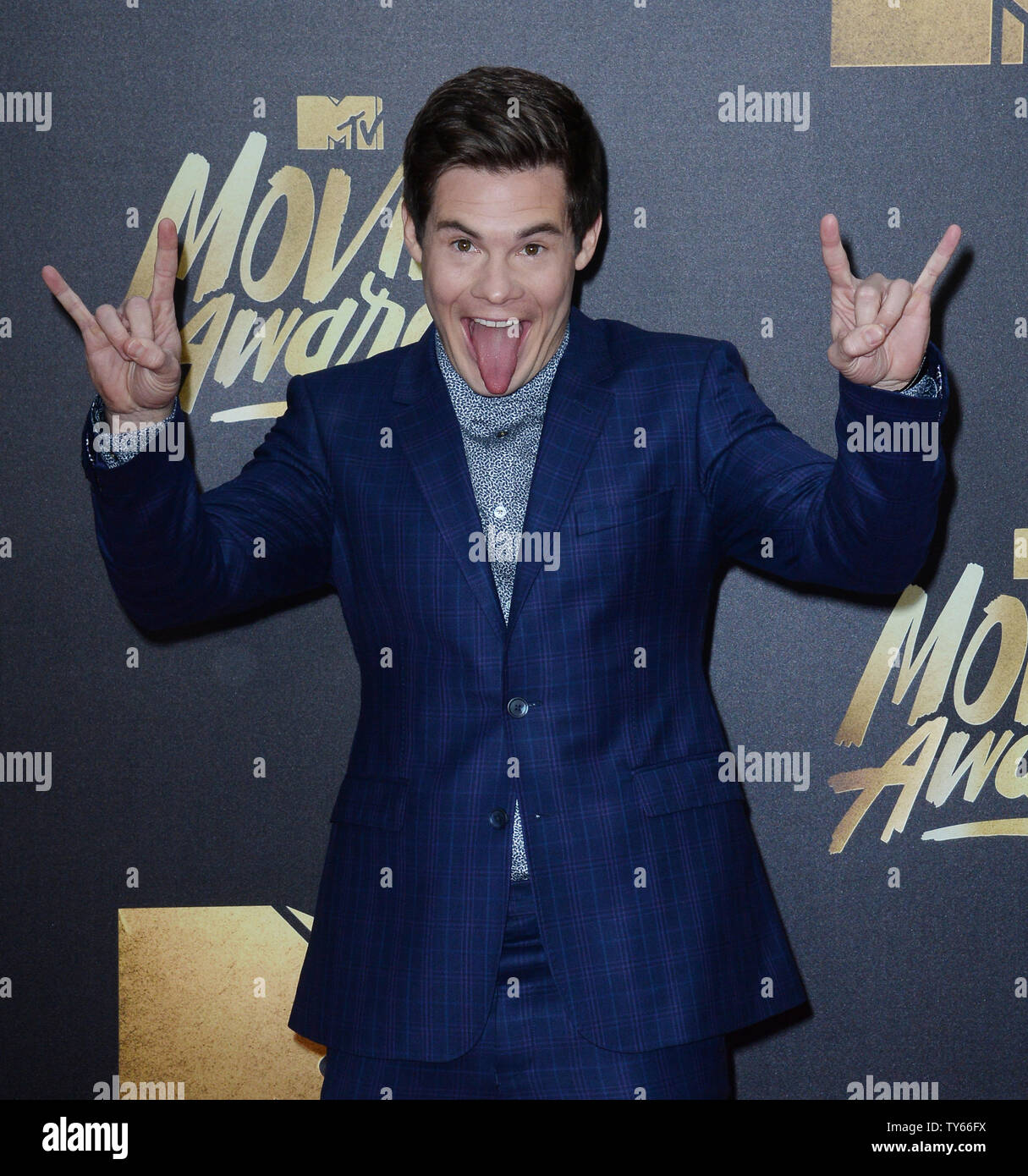 Actor Adam DeVine attends the MTV Movie Awards at Warner Bros. Studios in Burbank, California on April 9, 2016. The MTV Movie Awards airs Sunday, April 10 at 8pm ET/PT.  Photo by Jim Ruymen/UPI - Stock Image