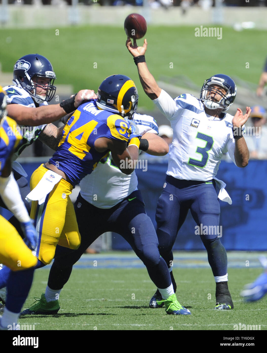 Seattle Seahawks Quarterback Russell Wilson Throws A Long Pass Against The Los Angeles Rams In The