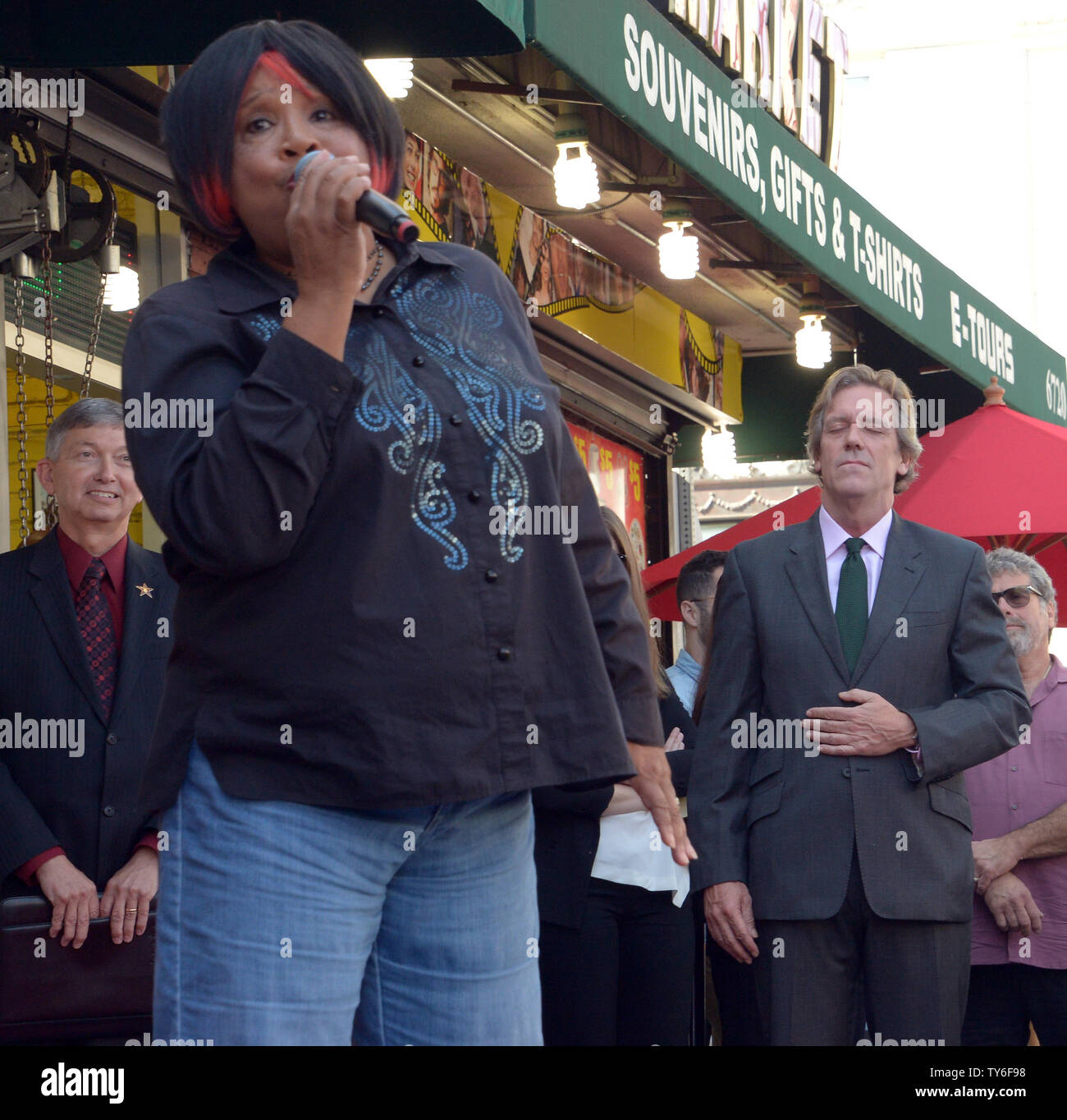 Singer Pepper Mashay serenades English actor Hugh Laurie during an unveiling ceremony honoring Laurie with the 2,593rd star on the Hollywood Walk of Fame in Los Angeles on October 25, 2016.  Photo by Jim Ruymen/UPI - Stock Image