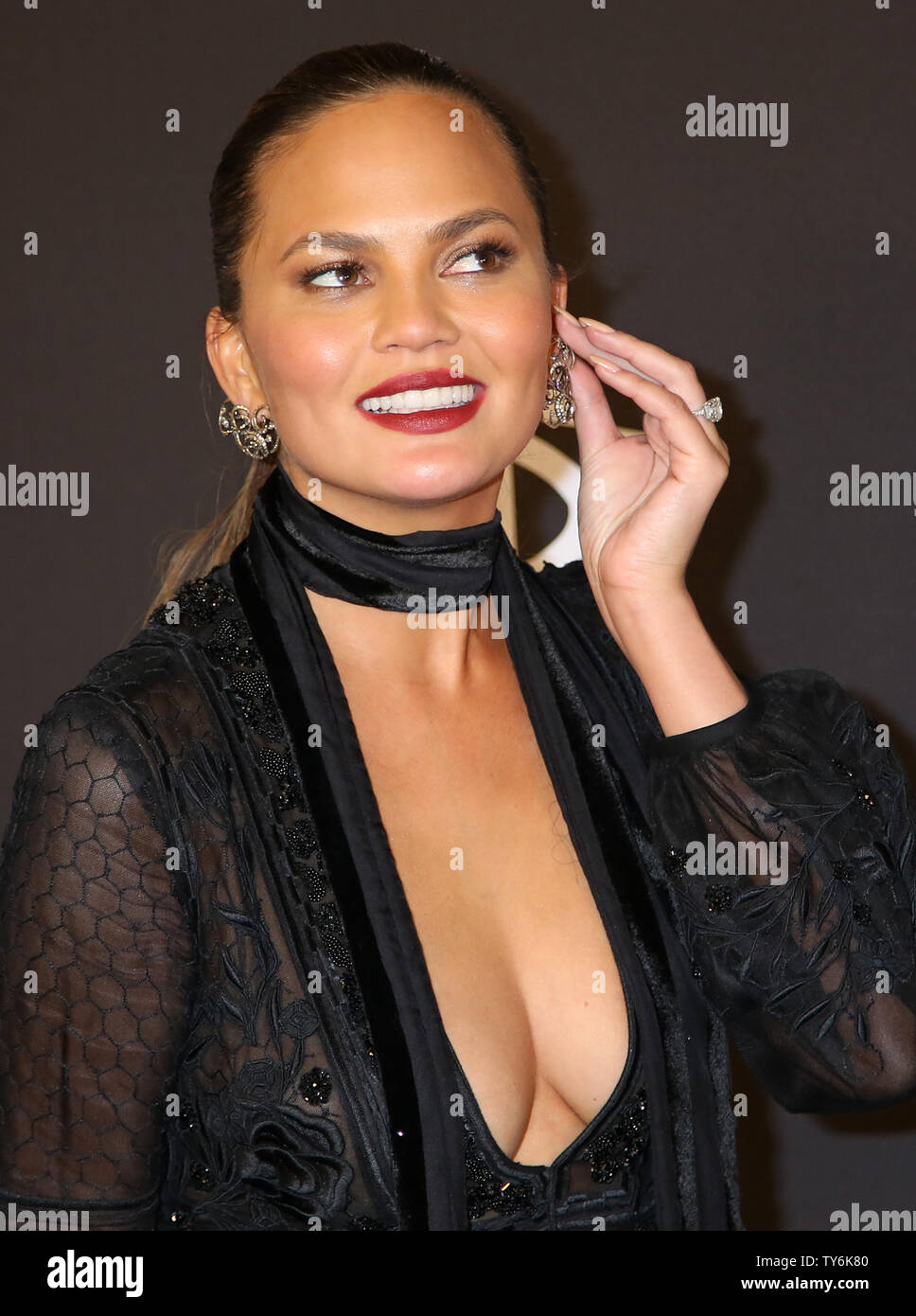 Chrissy Teigen attends the 18th annual InStyle and Warner Bros. Golden Globe after-party at the Beverly Hilton Hotel in Beverly Hills, California on January 8, 2017.  Photo by David Silpa/UPI - Stock Image