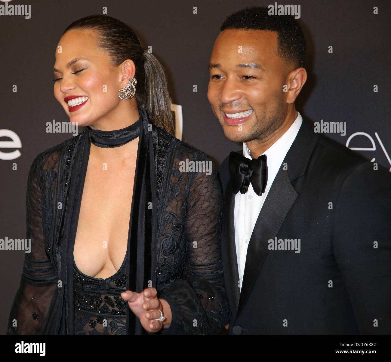 Chrissy Teigen (L) and John Legend attend the 18th annual InStyle and Warner Bros. Golden Globe after-party at the Beverly Hilton Hotel in Beverly Hills, California on January 8, 2017.  Photo by David Silpa/UPI - Stock Image