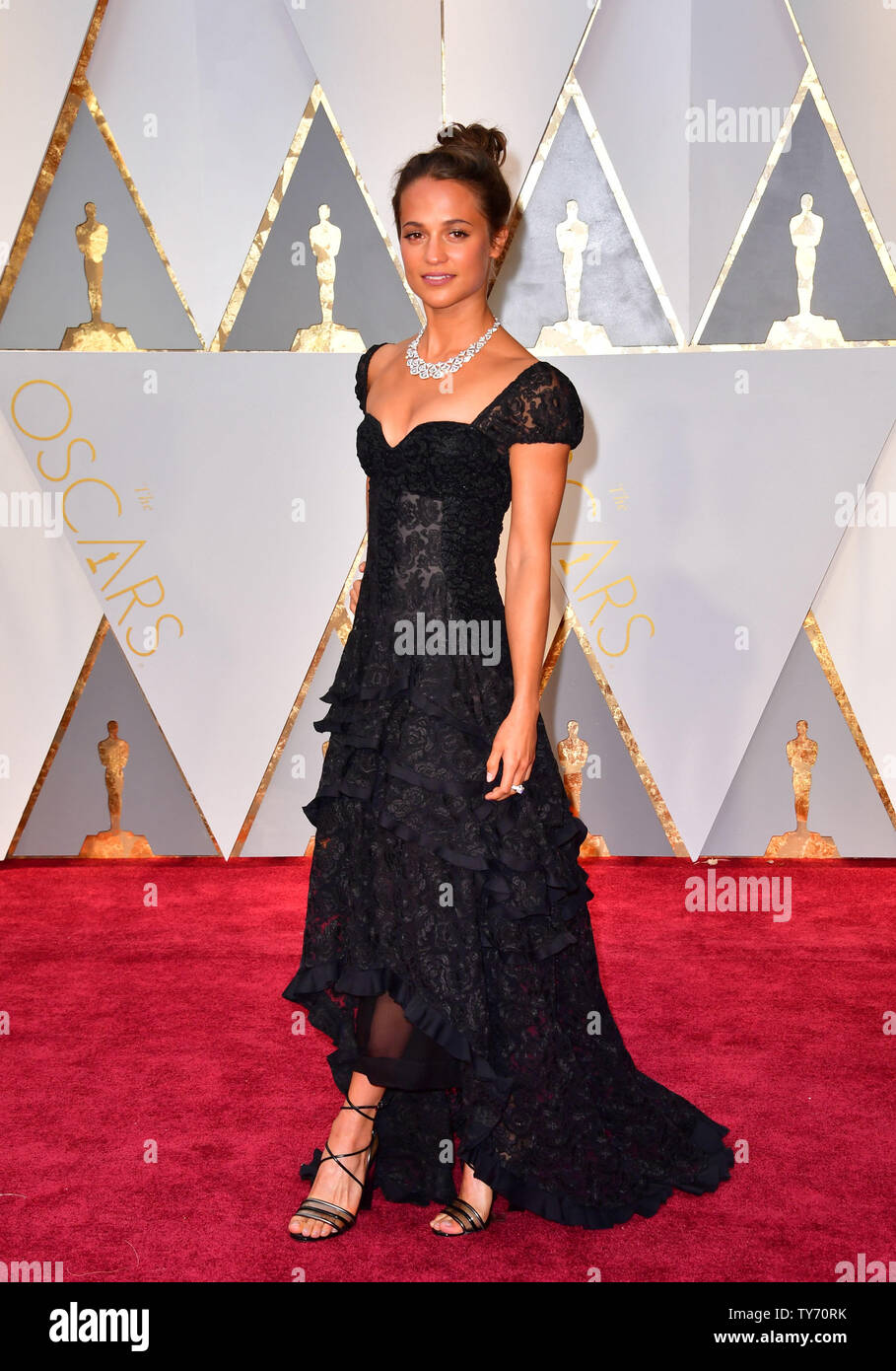 Alicia Vikander arrives on the red carpet for the 89th