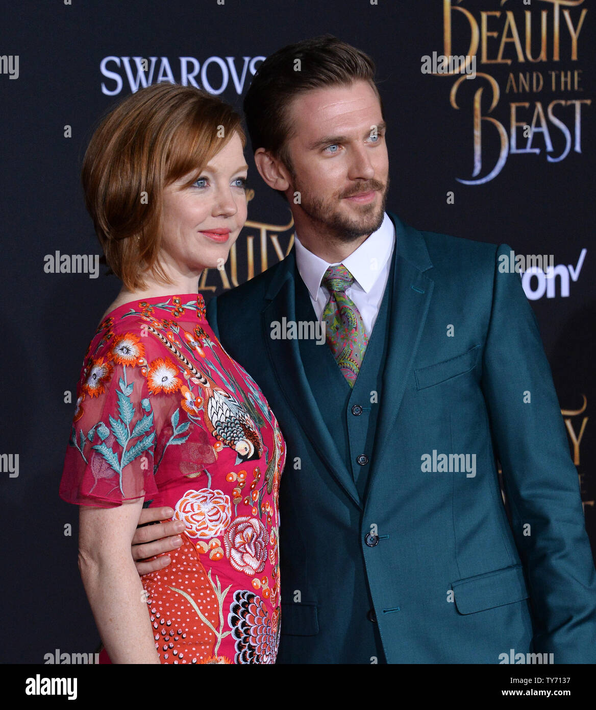 Cast member Dan Stevens and his wife Susie Hariet attend the