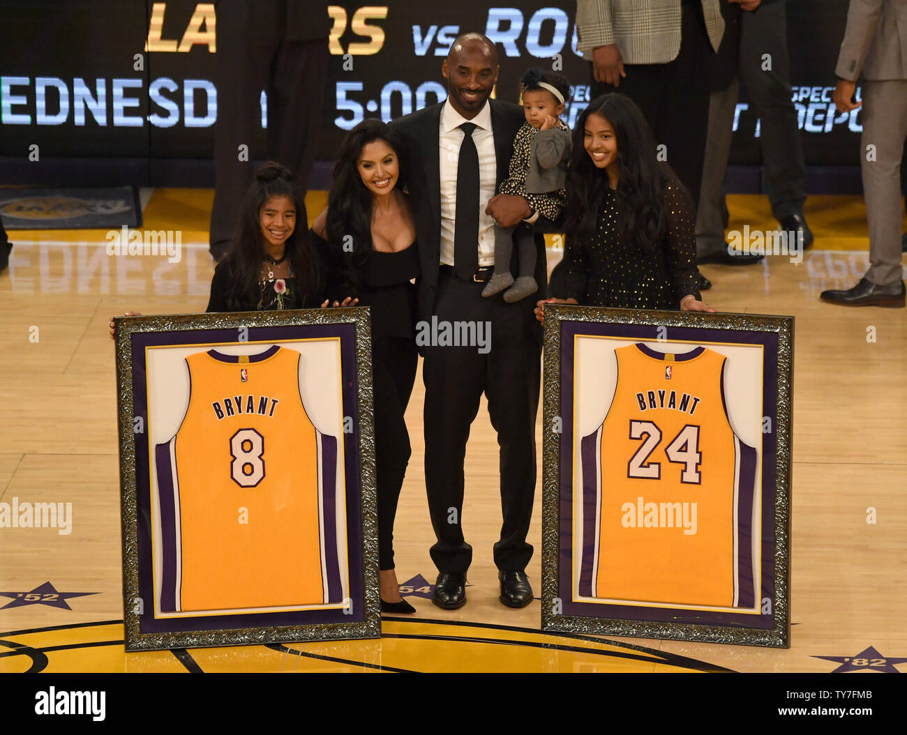 info for 3e759 5c08b Former Laker Kobe Bryant poses with his family during his ...