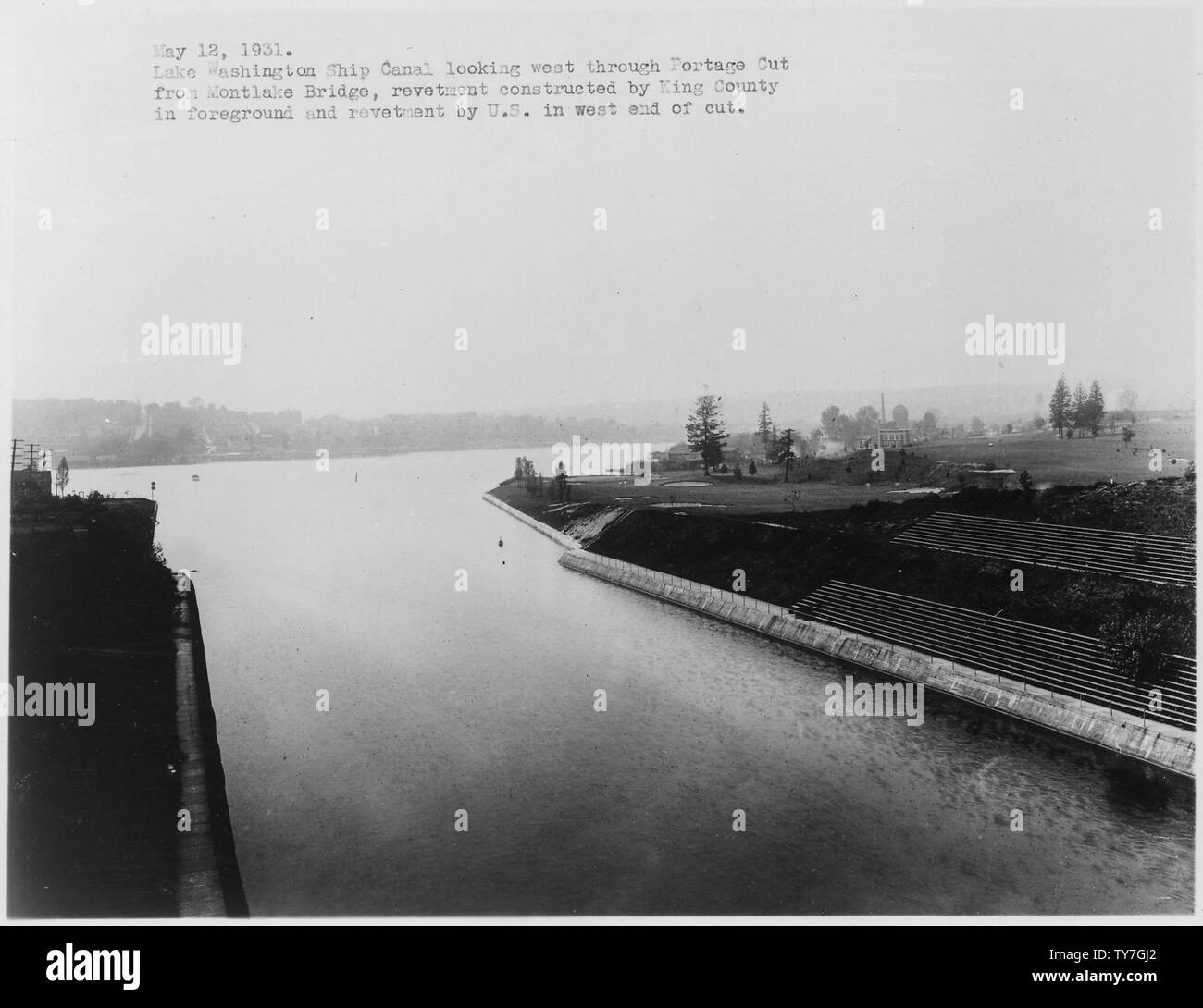 Lake Washington Ship Canal, U.S. Government Locks, Seattle, Washington. Looking west through Portage Cut from Montlake Bridge, showing revetment constructed by King County in foreground and revetment by U.S. in west end of cut.; Scope and content:  The US Army Corps of Engineers extensively photographed many of the Civil Works project and river and harbor improvement that they were involved with. The Lake Washington Ship Canal and the Hiram Chittenden Locks were built to allow passage between fresh water Lake Union and salt water Puget Sound. Stock Photo