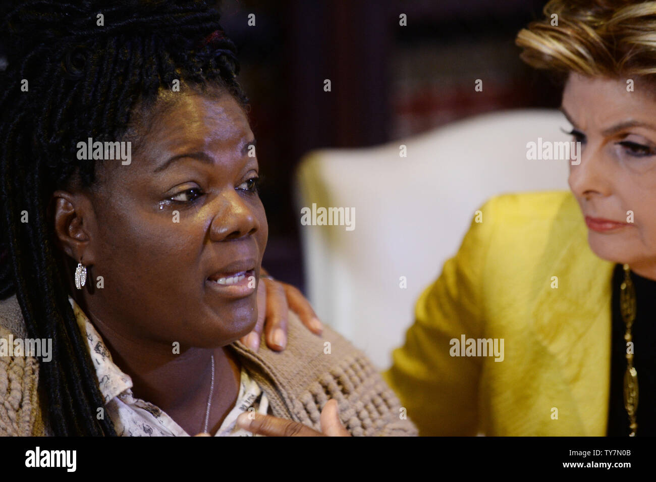 Essie Grundy (L) answers questions from reporters after