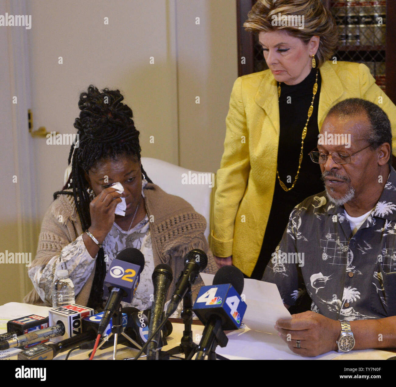 Essie Grundy (L) wipes away tears after accusing Walmart of racial