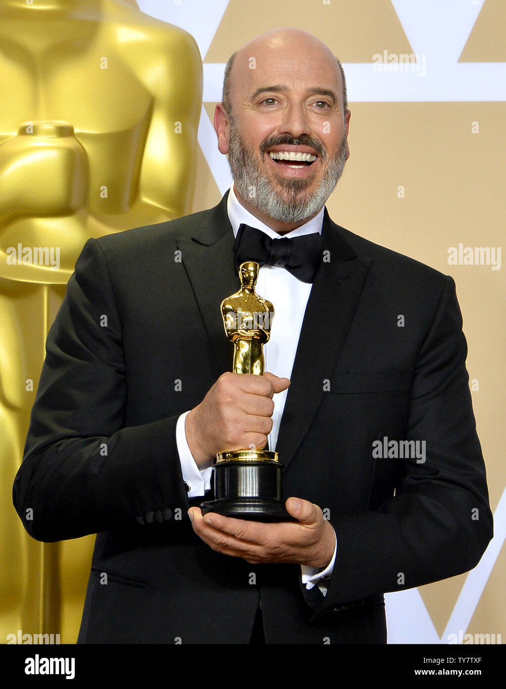 Mark Bridges Winner Of The Award For Best Costume Design For Phantom Thread Appears Backstage With His Oscar During The 90th Annual Academy Awards At Loews Hollywood Hotel In The Hollywood Section
