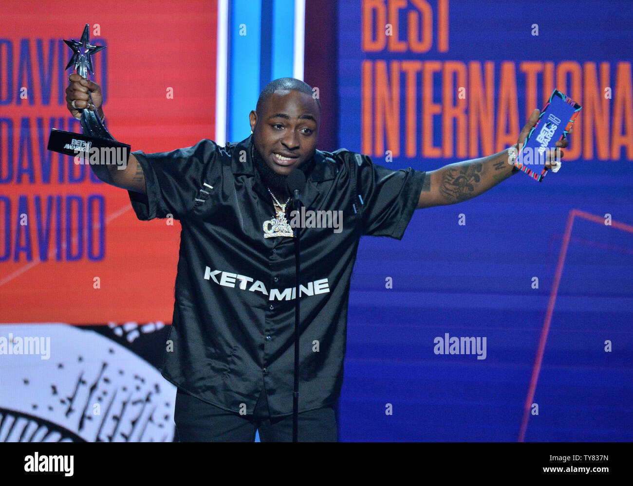 Davido accepts Best International Act award onstage during