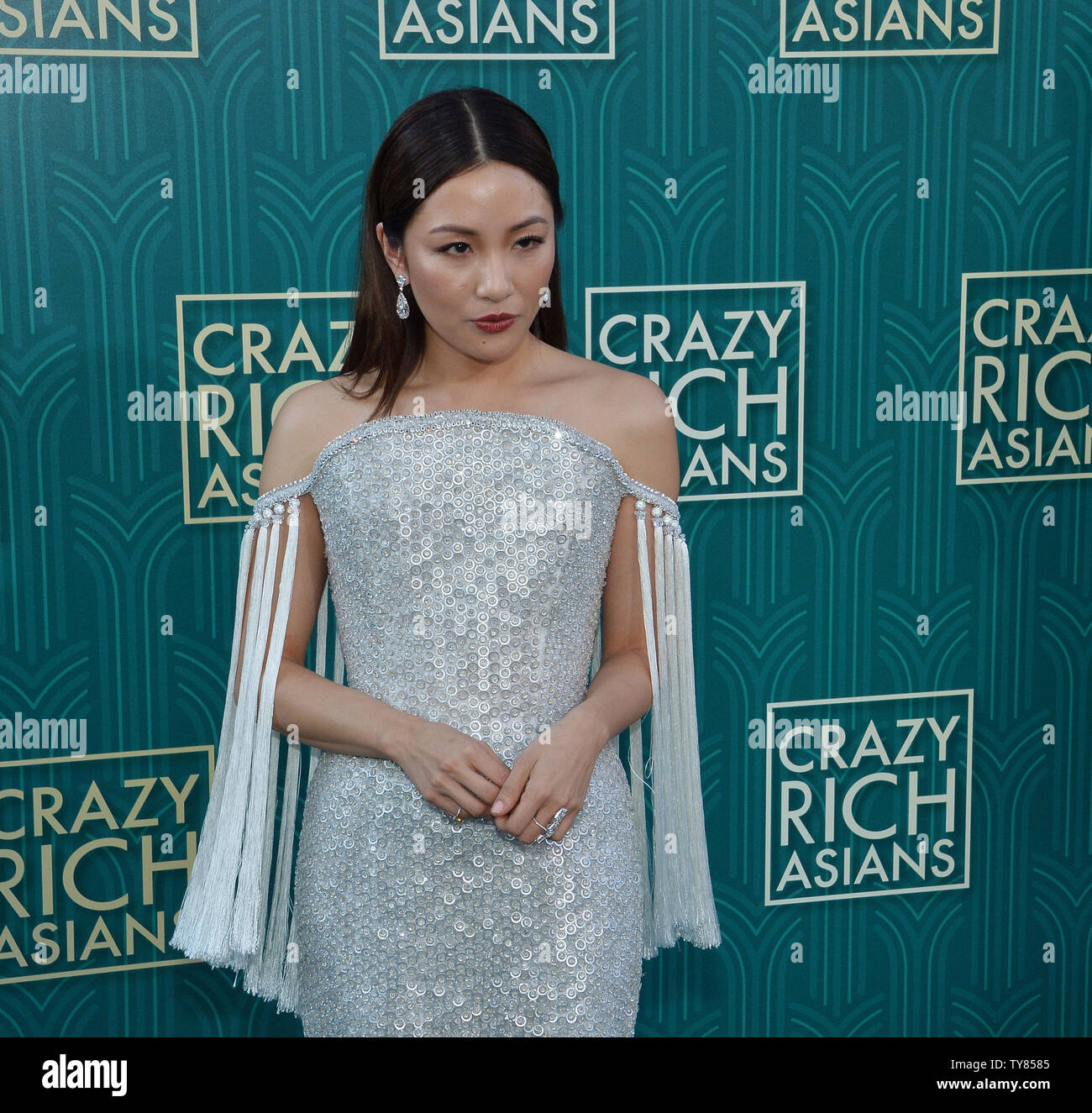 Cast member Constance Wu attends the premiere of the motion picture comedy 'Crazy Rich Asians' at the TCL Chinese Theatre in the Hollywood section of Los Angeles on July 7, 2018. The story follows Rachel Chu (Wu), an American-born Chinese economics professor, who travels to her boyfriend Nick's (Henry Golding) hometown of Singapore for his best friend's wedding. Before long, his secret is out: Nick is from a family that is impossibly wealthy, he's perhaps the most eligible bachelor in Asia, and every single woman in his ultra-rarefied social class is incredibly jealous of Rachel and wants to b - Stock Image