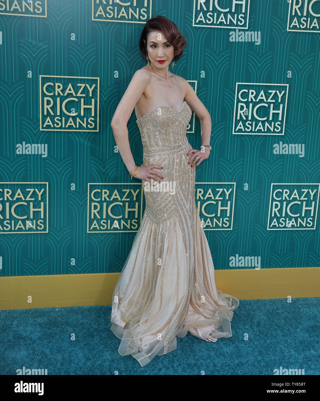 Cast member Amy Cheng attends the premiere of the motion picture comedy 'Crazy Rich Asians' at the TCL Chinese Theatre in the Hollywood section of Los Angeles on July 7, 2018. The story follows Rachel Chu (Wu), an American-born Chinese economics professor, who travels to her boyfriend Nick's (Henry Golding) hometown of Singapore for his best friend's wedding. Before long, his secret is out: Nick is from a family that is impossibly wealthy, he's perhaps the most eligible bachelor in Asia, and every single woman in his ultra-rarefied social class is incredibly jealous of Rachel and wants to brin - Stock Image