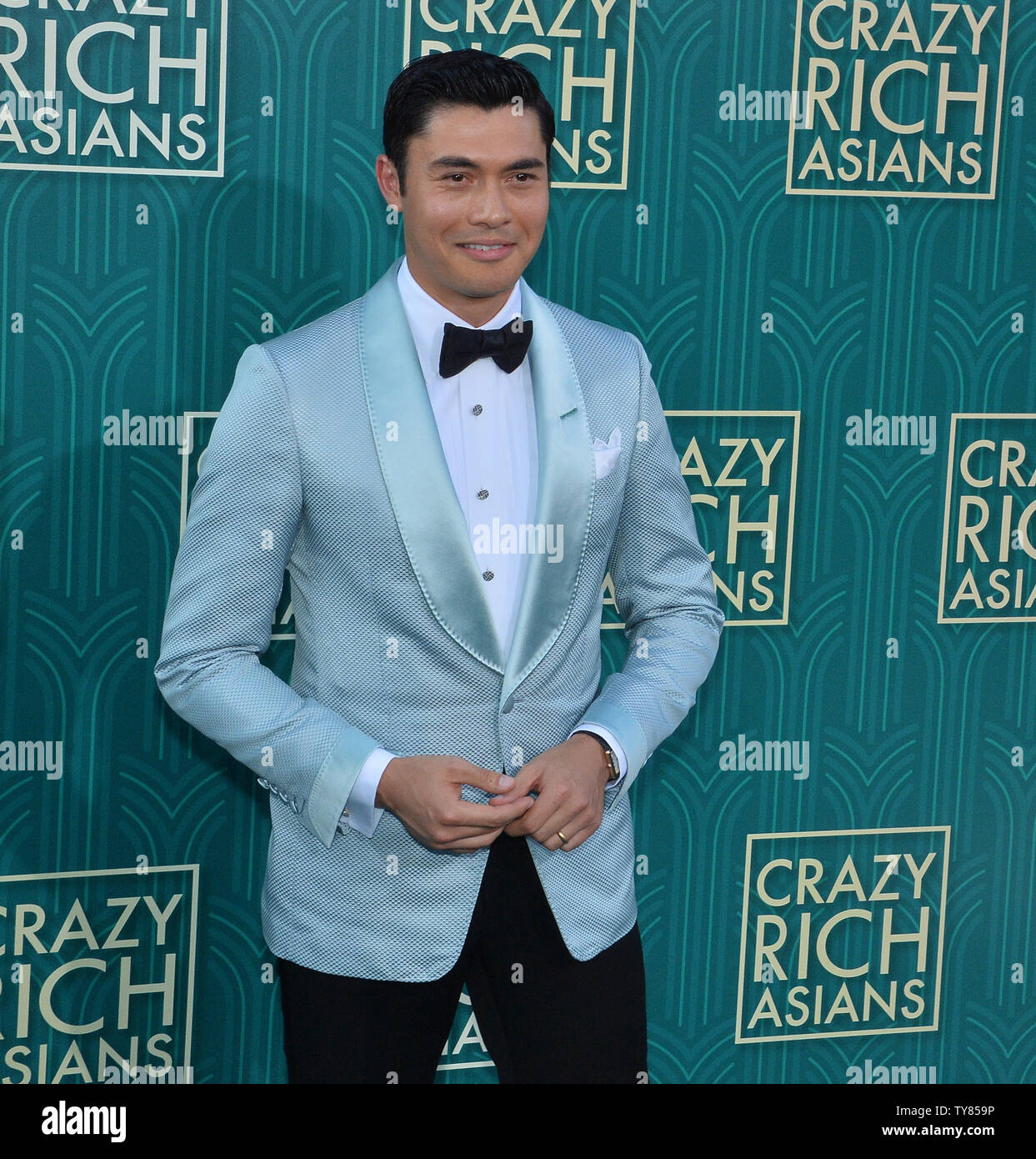 Cast member Henry Golding attends the premiere of the motion picture comedy 'Crazy Rich Asians' at the TCL Chinese Theatre in the Hollywood section of Los Angeles on July 7, 2018. The story follows Rachel Chu (Wu), an American-born Chinese economics professor, who travels to her boyfriend Nick's (Henry Golding) hometown of Singapore for his best friend's wedding. Before long, his secret is out: Nick is from a family that is impossibly wealthy, he's perhaps the most eligible bachelor in Asia, and every single woman in his ultra-rarefied social class is incredibly jealous of Rachel and wants to - Stock Image